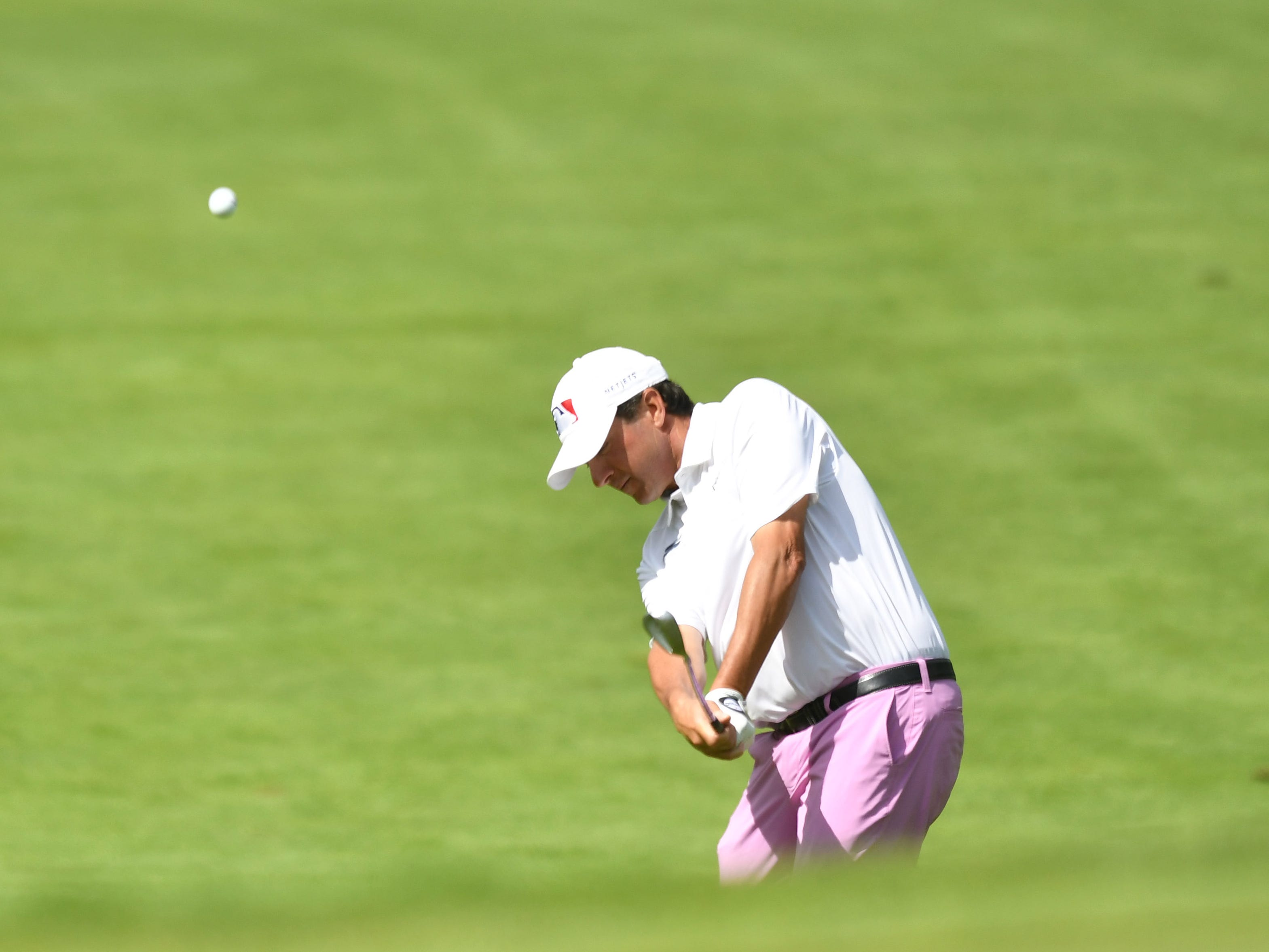 Billy Andrade hits his approach shot on the first hole at the Ally Challenge.