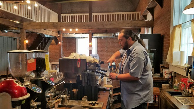 Kyle Tharp of Lucid coffee prepares an espresso drink at Lucid's Newburgh Country Store location.