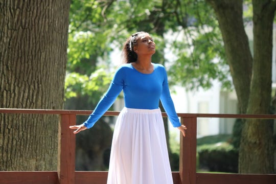 Troyonah Darby, sister of Jaylan Brock, who was shot and killed last year, performs an interpretive dance at his memorial on Saturday.