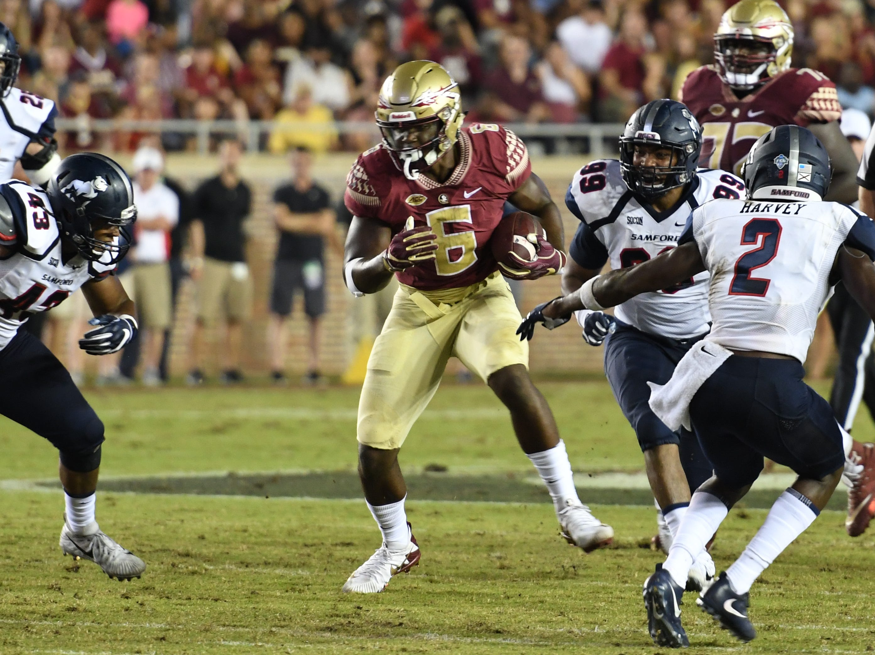 FSU sophomore tight end Tre' McKitty (6) working through the Samford defense during the second quarter of FSU's game against Samford on Saturday night at Doak Campbell Stadium.