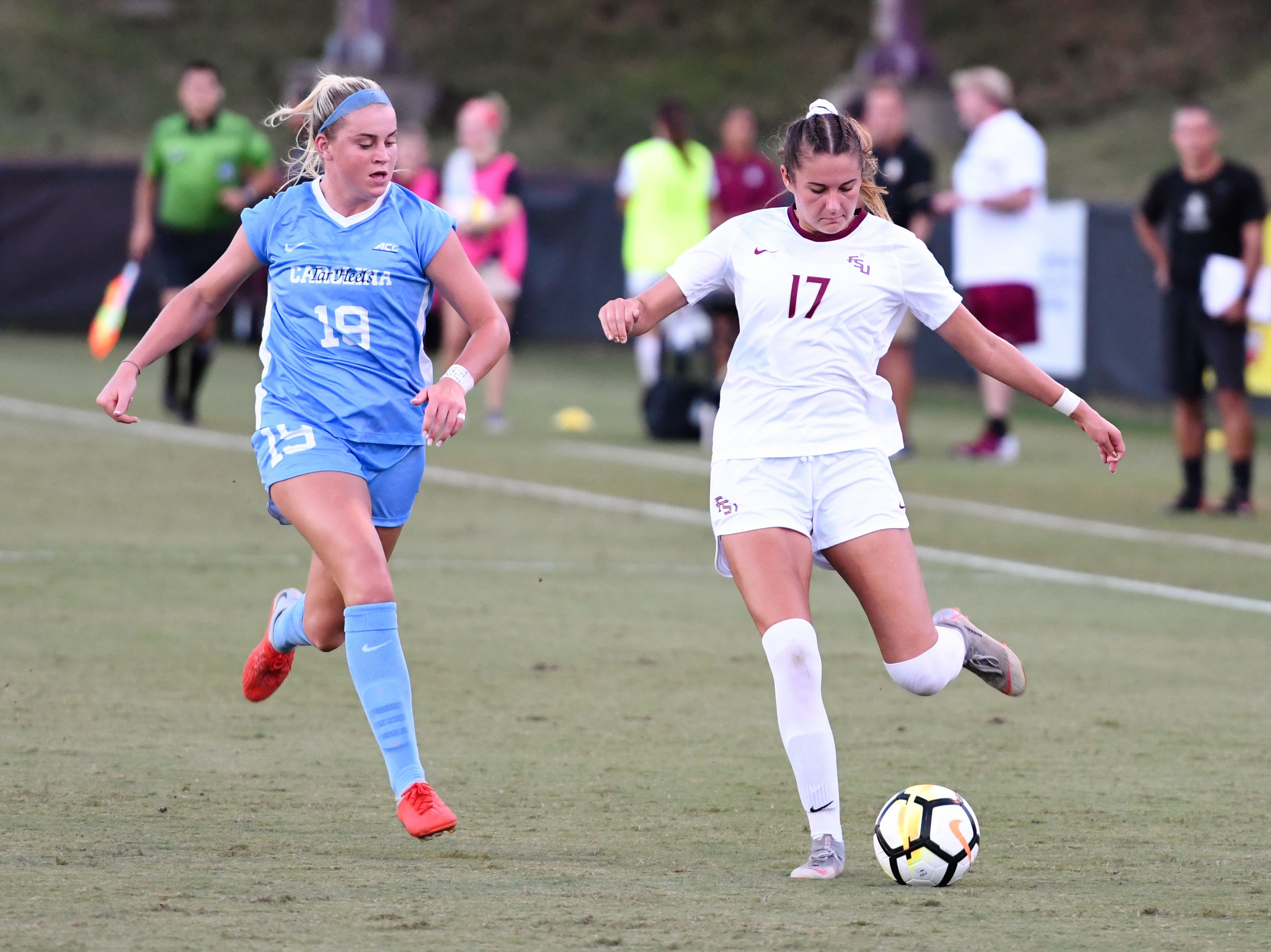 FSU redshirt sophomore defender Malia Berkely (17) passing the ball towards her teammates during the first half of FSU's game against UNC on September 14th at the Seminole Soccer Complex.