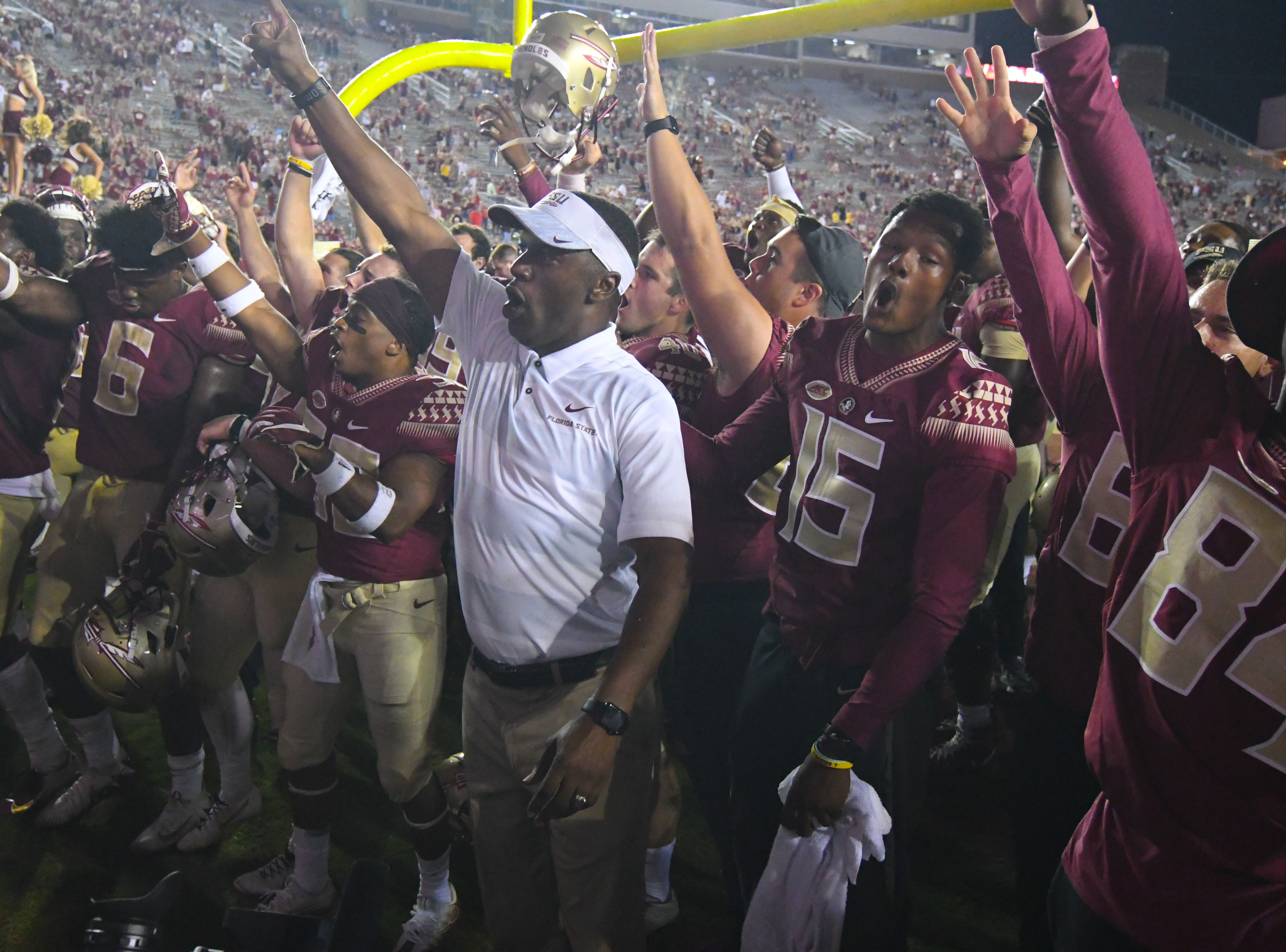 FSU head coach Willie Taggart celebrating his first career win at FSU over Samford by singing the FSU fight song on Saturday night at Doak Campbell Stadium.