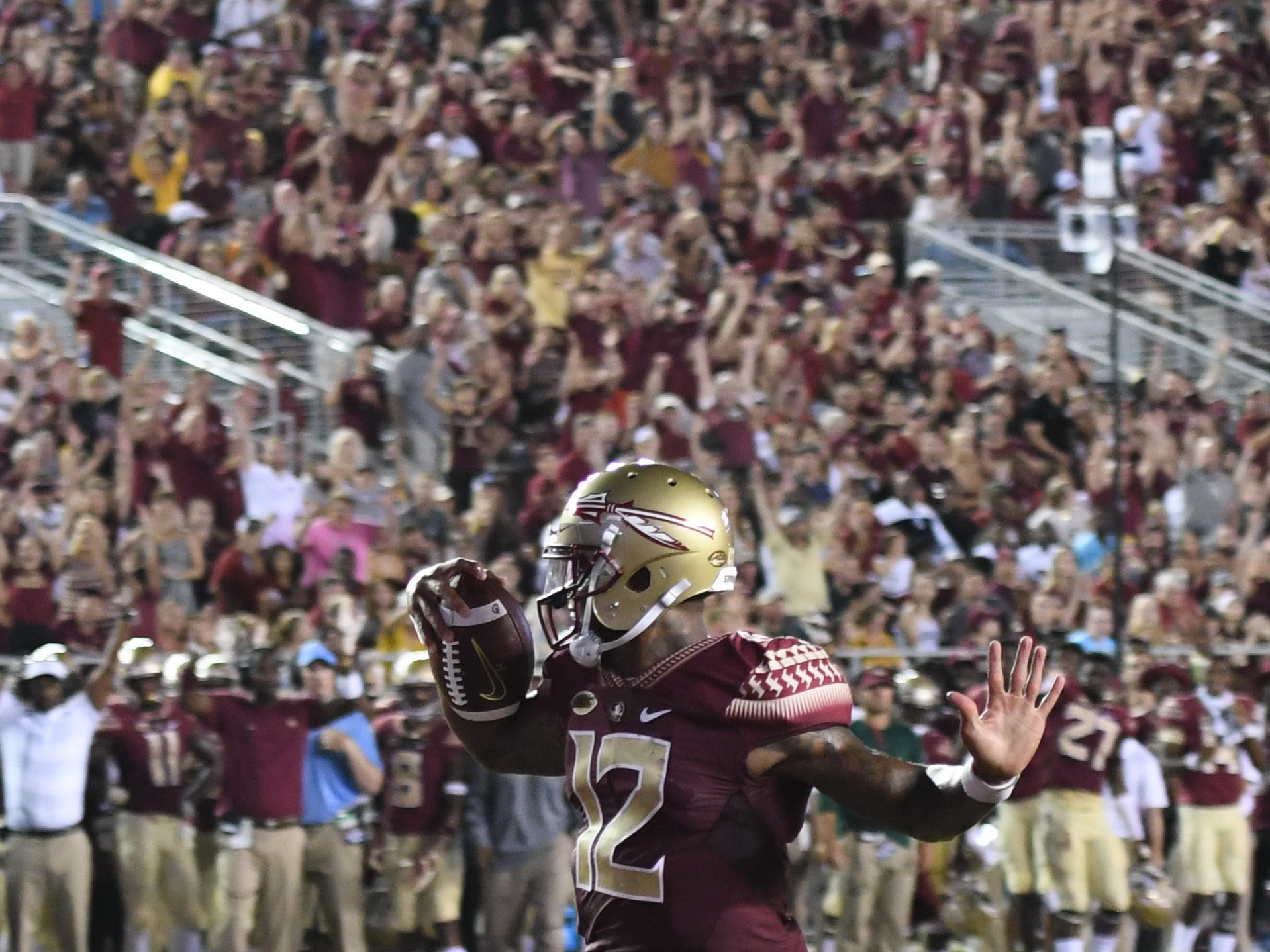 FSU redshirt junior Deondre Francois (12) scoring a touchdown on a quarterback sneak during the second quarter of FSU's matchup against Samford on Saturday night at Doak Campbell Stadium.