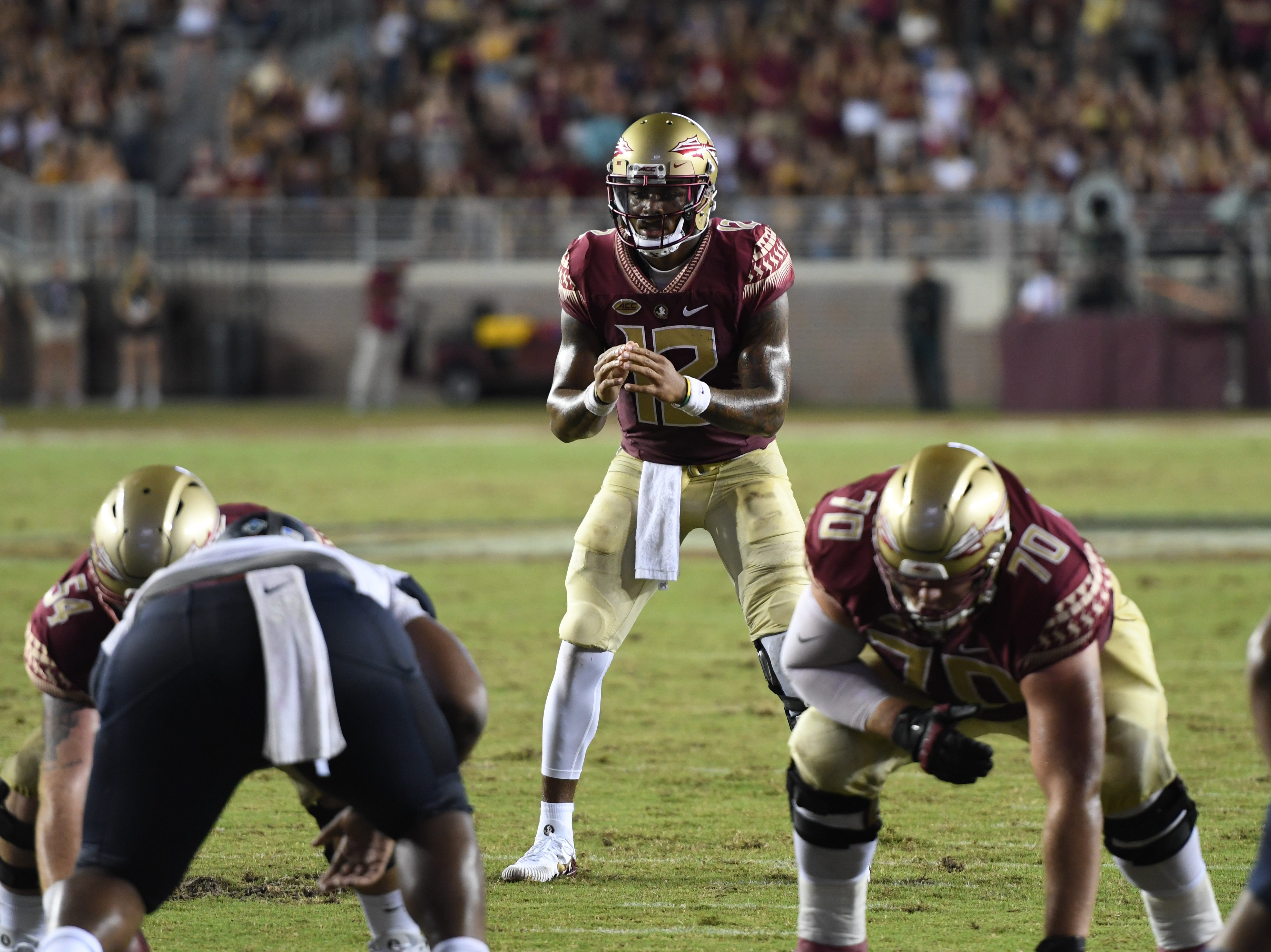 FSU redshirt junior Deondre Francois (12) under center during the second quarter of FSU's matchup against Samford on Saturday night at Doak Campbell Stadium.