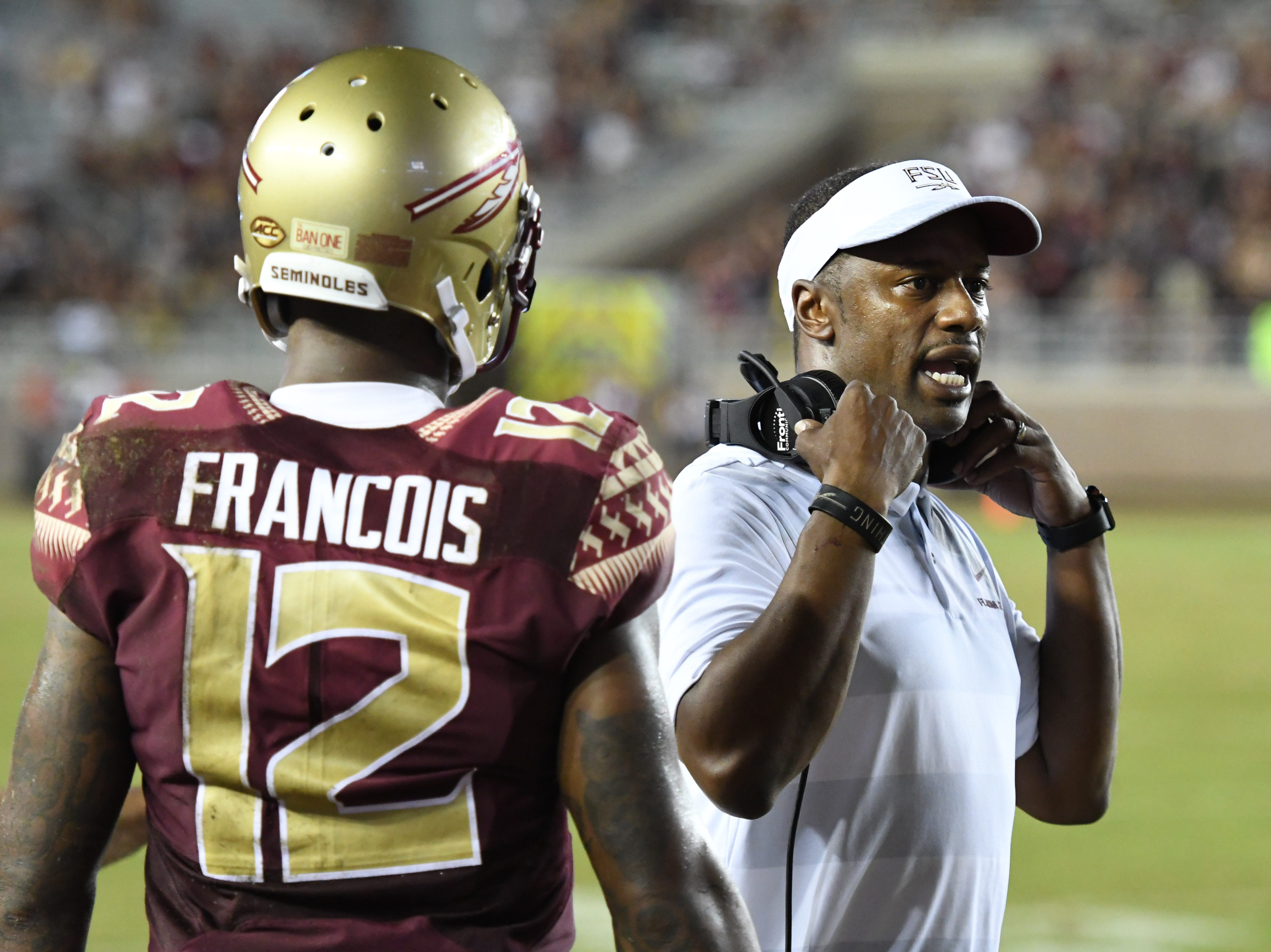 FSU head coach Willie Taggart speaking to an official during the thrid quarter of FSU's game against Samford on Saturday night at Doak Campbell Stadium.