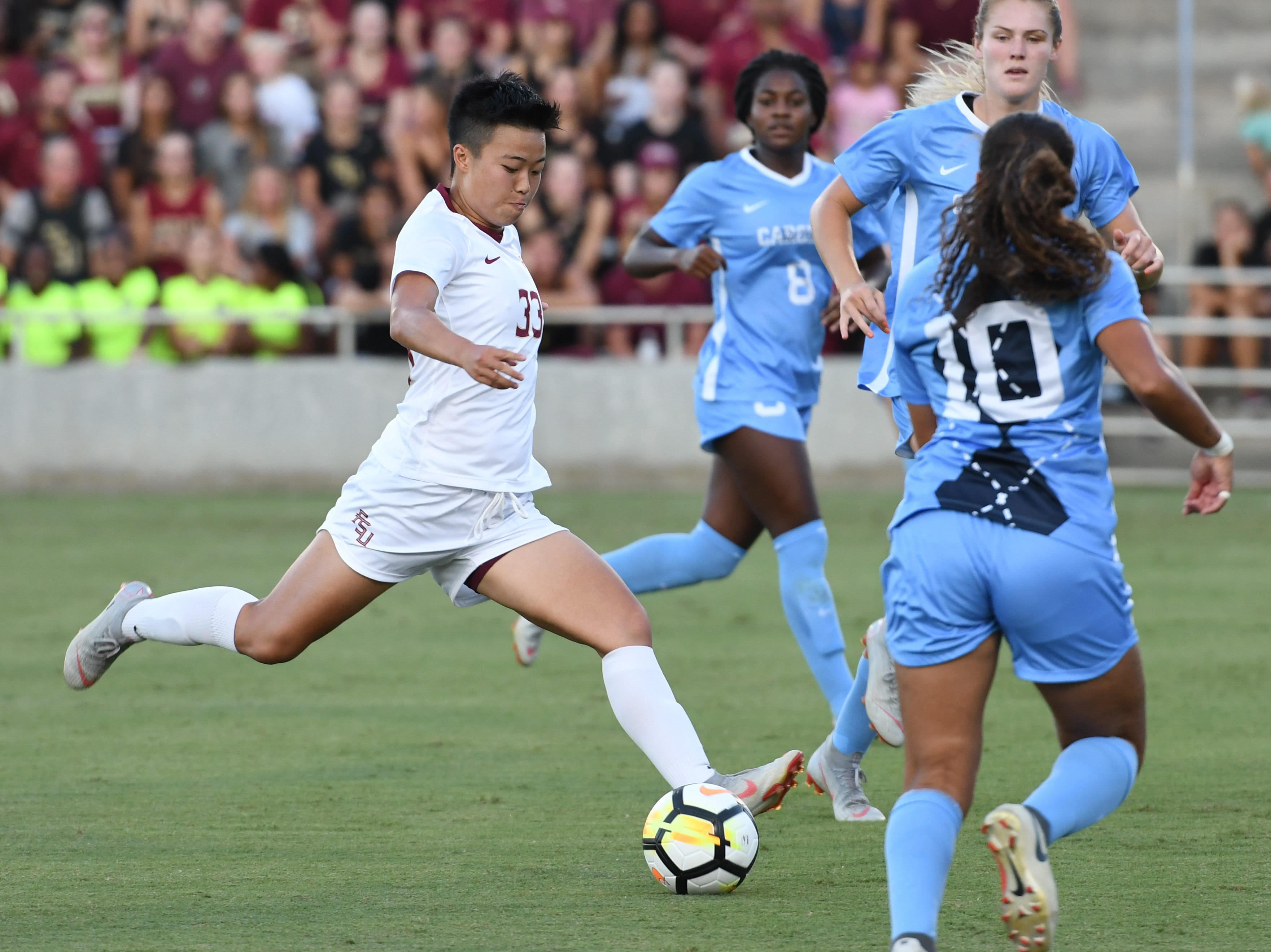 FSU freshman midfielder Yujie Zhao (33) taking a shot in the first half of FSU's game against UNC on September 14th at the Seminole Soccer Complex.