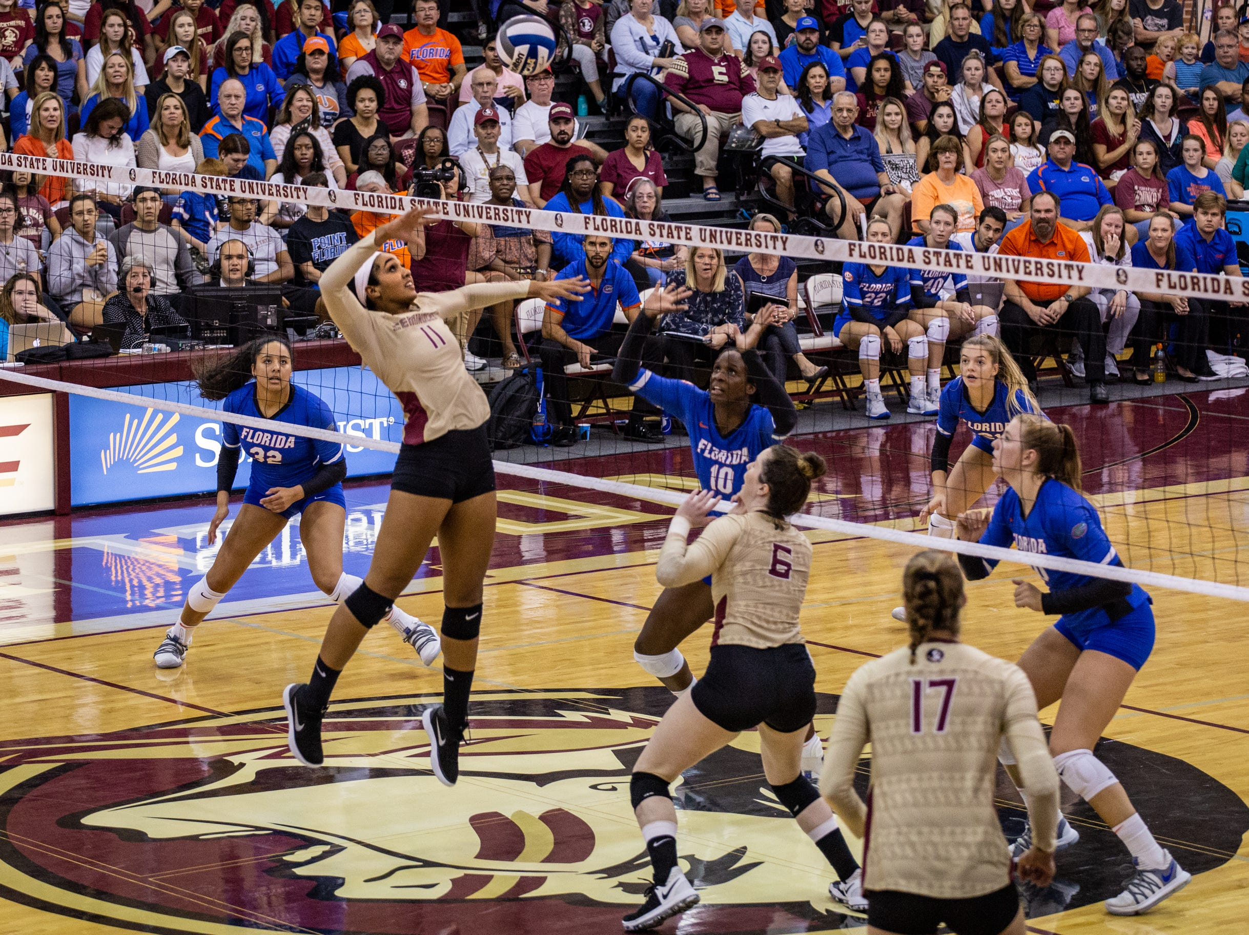 FSU middle blocker Ashley Murray (11) jumps to spike a ball back over the net during the first set against Florida at Tully Gymnasium on Wednesday.