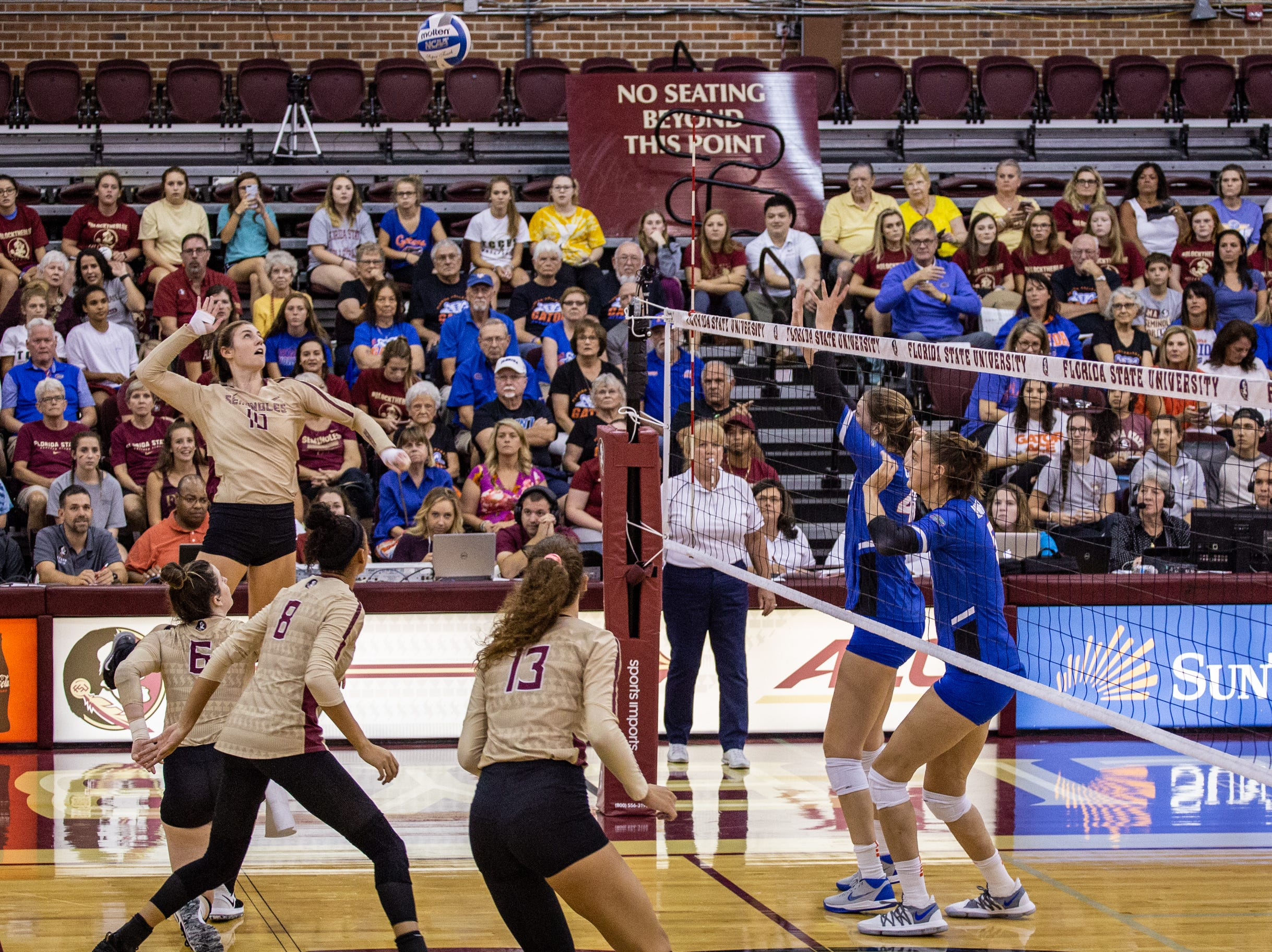 FSU outside hitter Christina Ambrose (10)  jumps to spike a ball over the net during the first set against Florida at Tully Gymnasium on Wednesday.