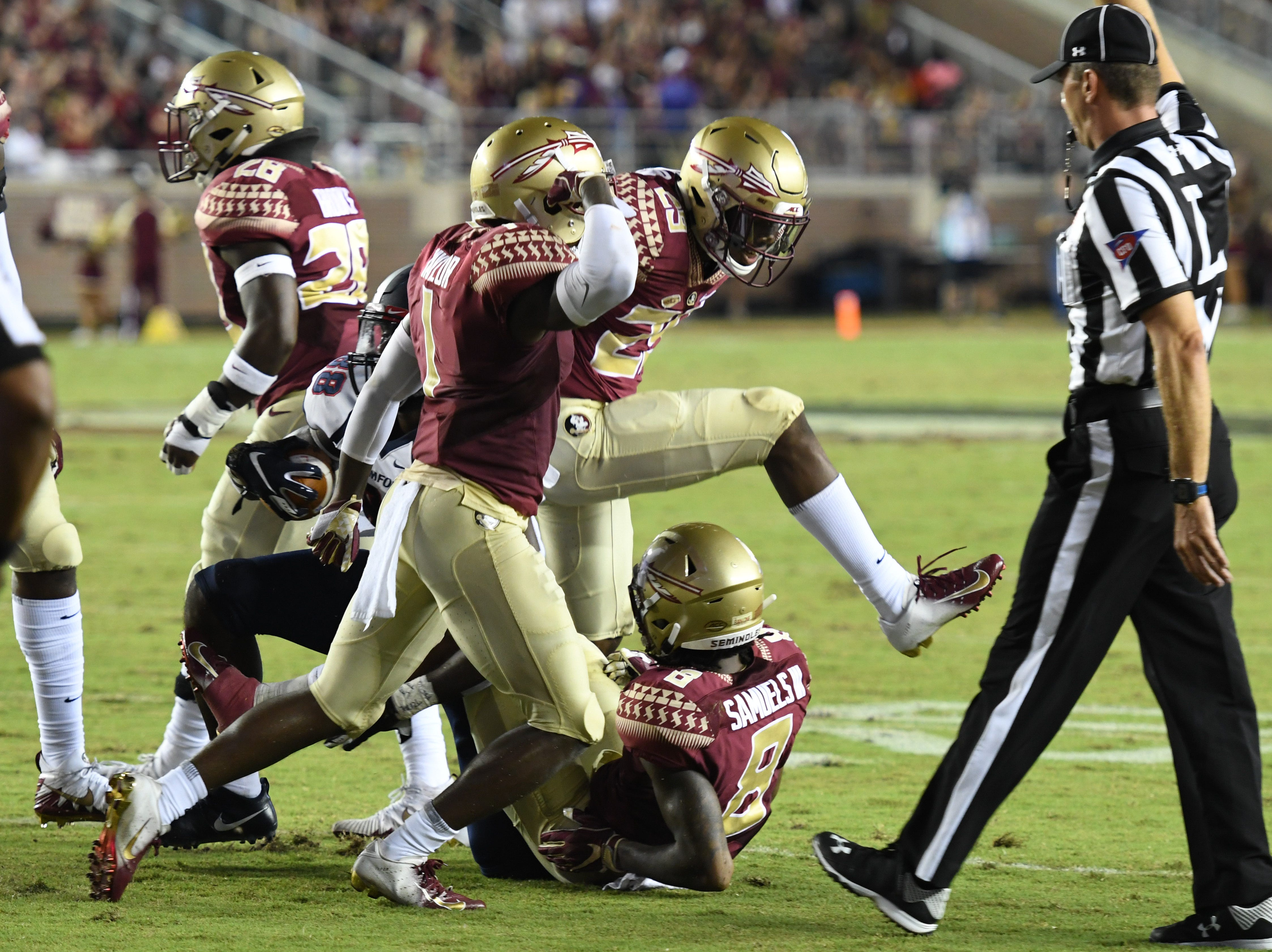 FSU's defense with a group tackle during the second quarter of FSU's game against Samford on Saturday night at Doak Campbell Stadium.