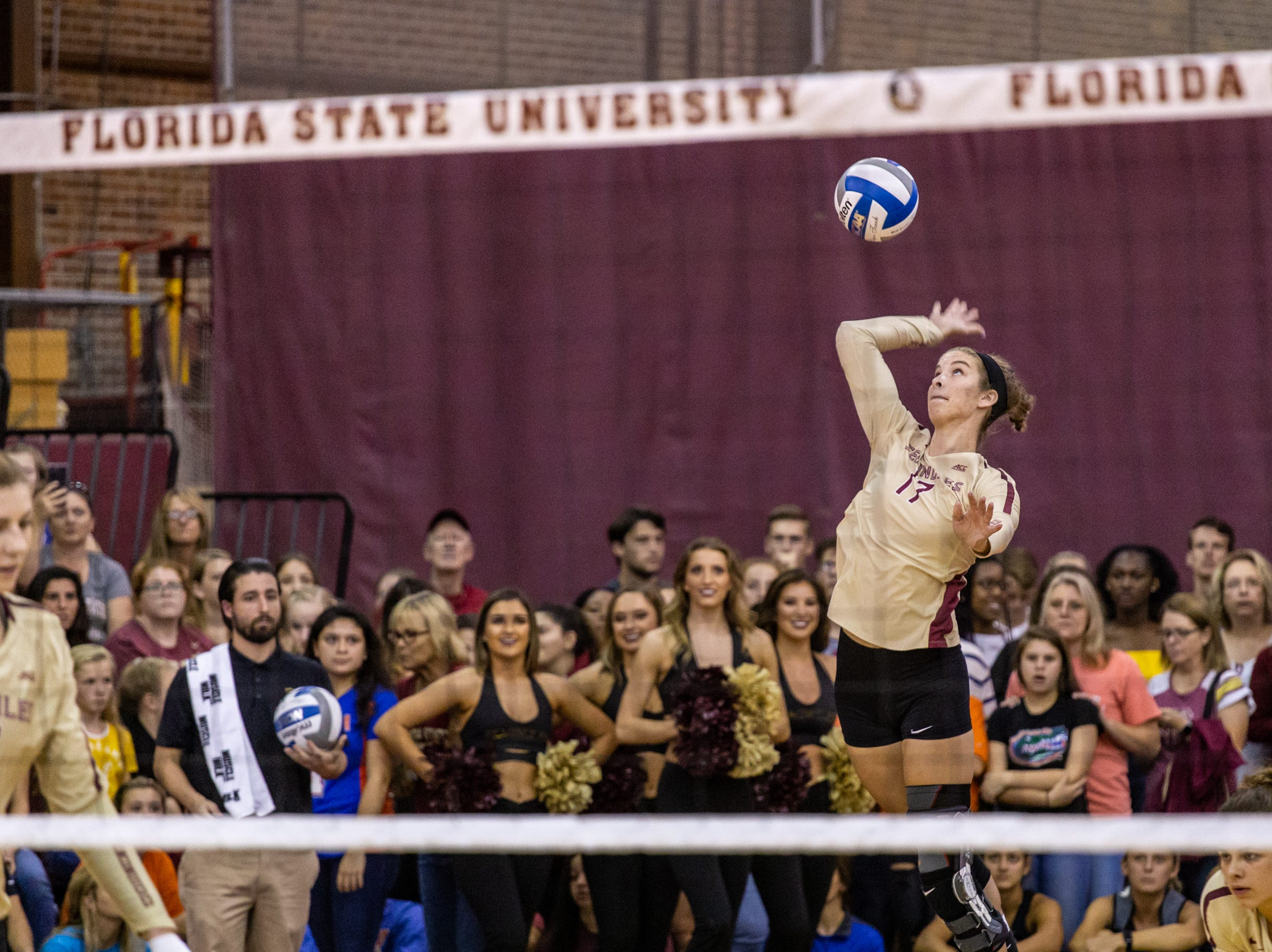 FSU setter Adrian Ell (17), serves during the first set against Florida at Tully Gymnasium on Wednesday.