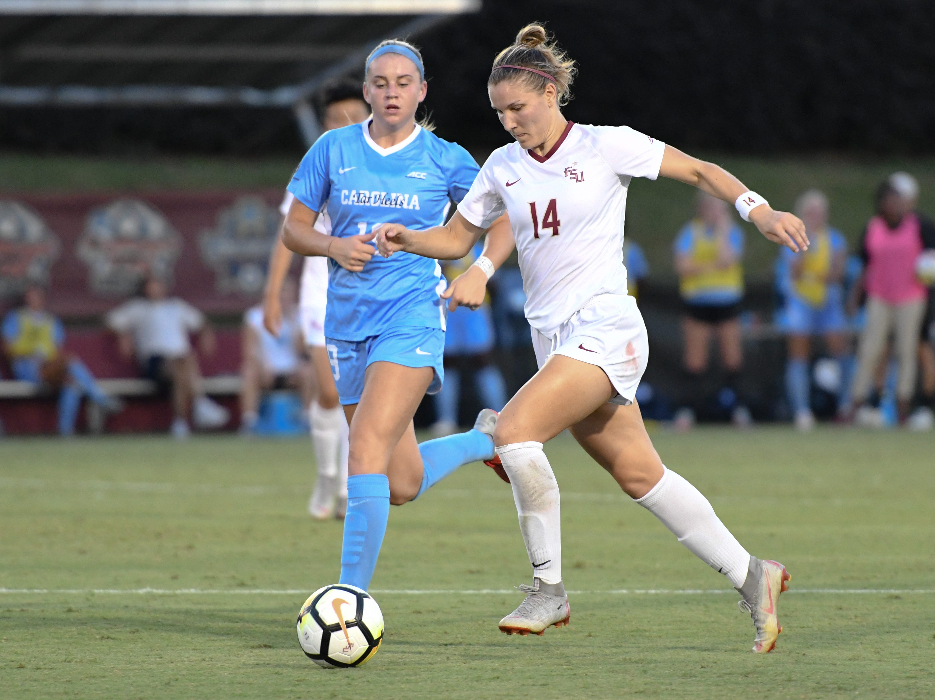 FSU senior defender Natalie Kuikka (14) moving the ball up to FSU's side of the field during the first half of FSU's game against UNC on September 14th at the Seminole Soccer Complex.