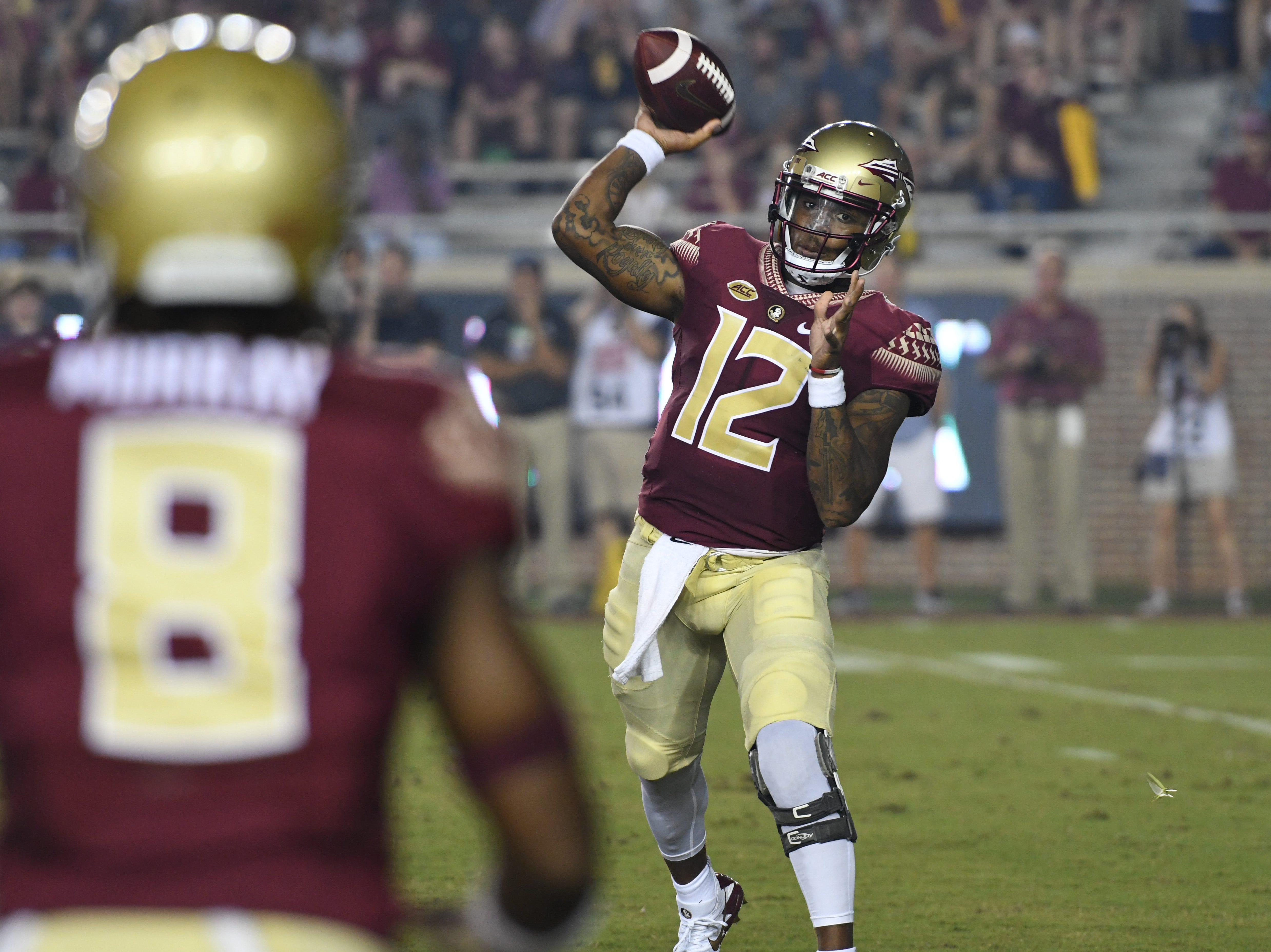 FSU redshirt junior Deondre Francois (12) throwing to Nyqwuan Murray (8) during the first quarter of FSU's matchup against Samford on Saturday night at Doak Campbell Stadium.