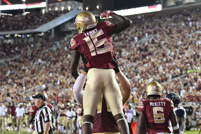 FSU redshirt freshman Tamorrion Terry (15) celebrating his first career touchdown in FSU's game against Samford on Saturday night at Doak Campbell Stadium.