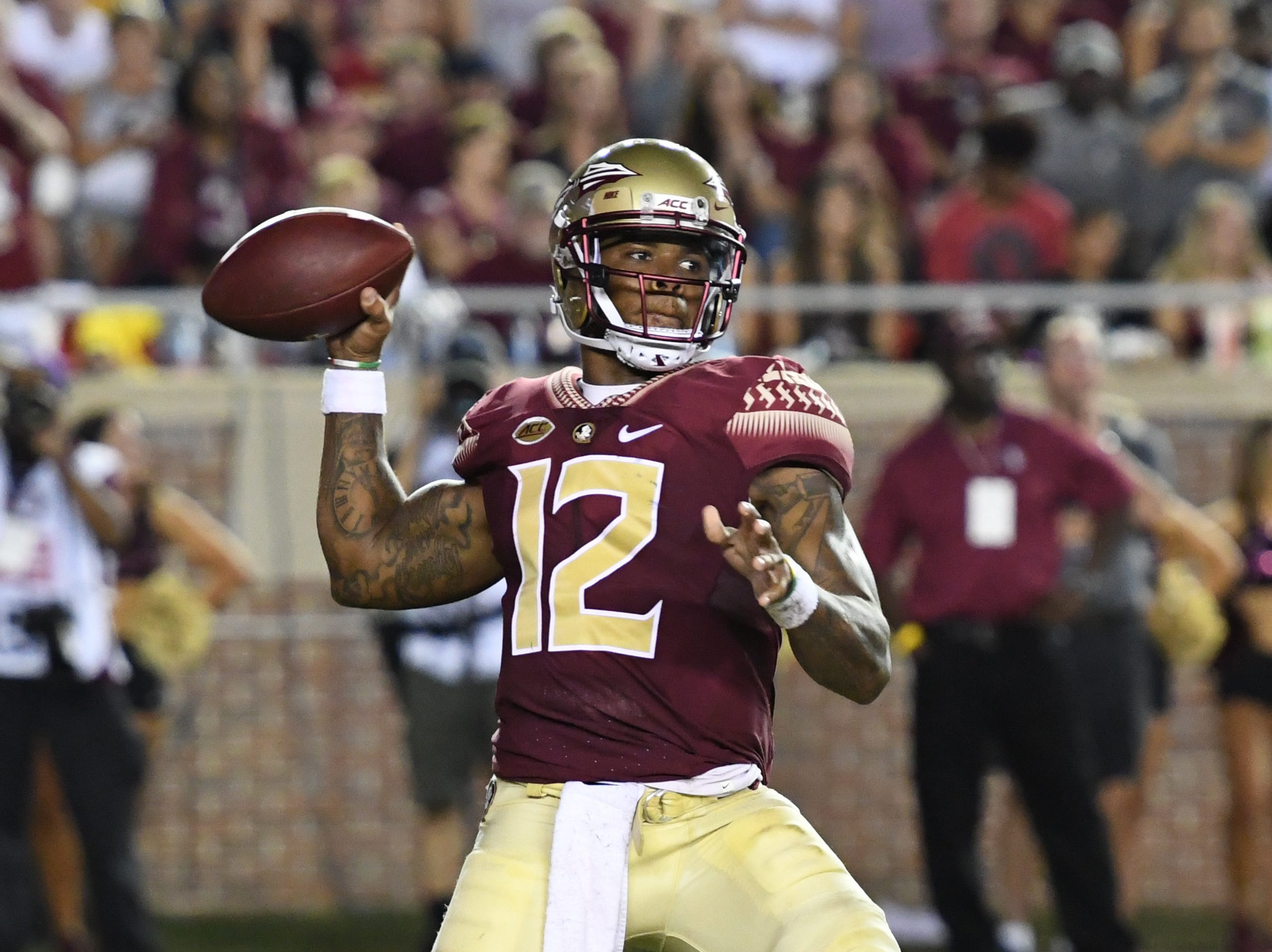 FSU redshirt junior Deondre Francois (12) throwing passing the football during the first quarter of FSU's matchup against Samford on Saturday night at Doak Campbell Stadium.