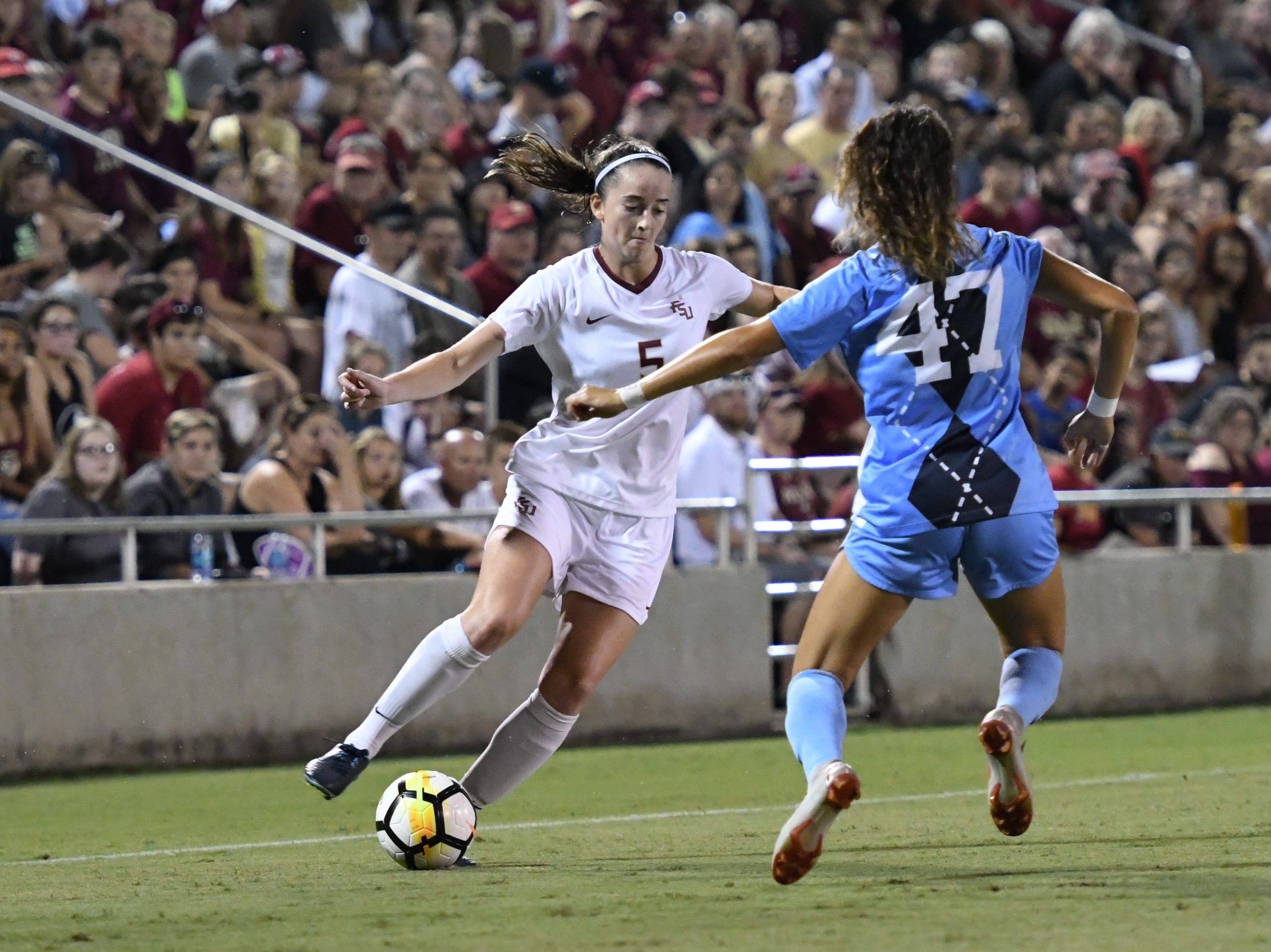FSU sophomore defender Anna Patten (5) trying to get by a UNC defender during the second half of FSU's game against UNC on September 14th at the Seminole Soccer Complex.