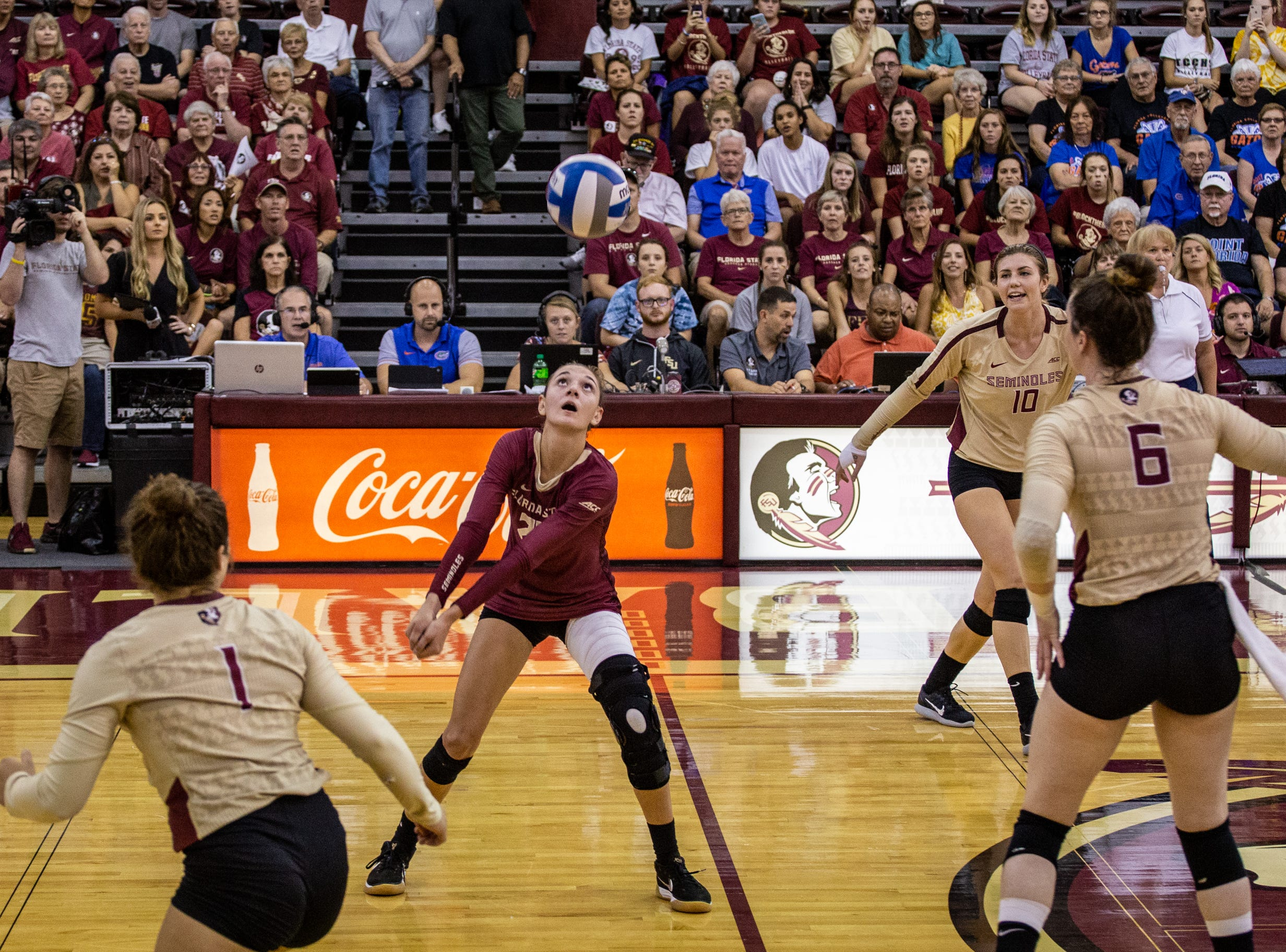 FSU libero Kelsey Wicinski (20) bumps a ball during the first set against Florida at Tully Gymnasium on Wednesday.