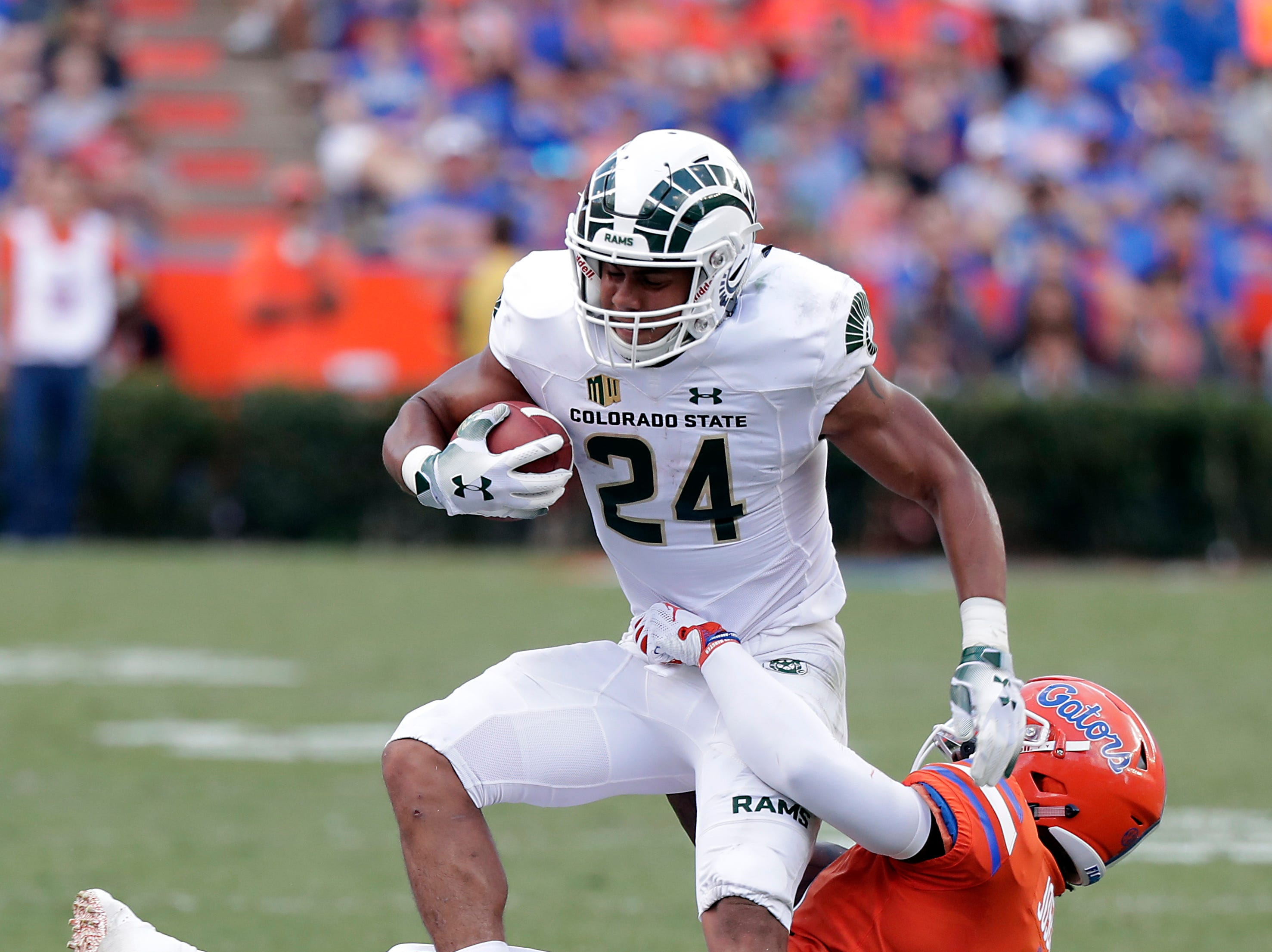 Colorado State running back Izzy Matthews (24) is stopped by Florida linebacker Vosean Joseph for no gain after a reception during the first half of an NCAA college football game, Saturday, Sept. 15, 2018, in Gainesville, Fla. (AP Photo/John Raoux)