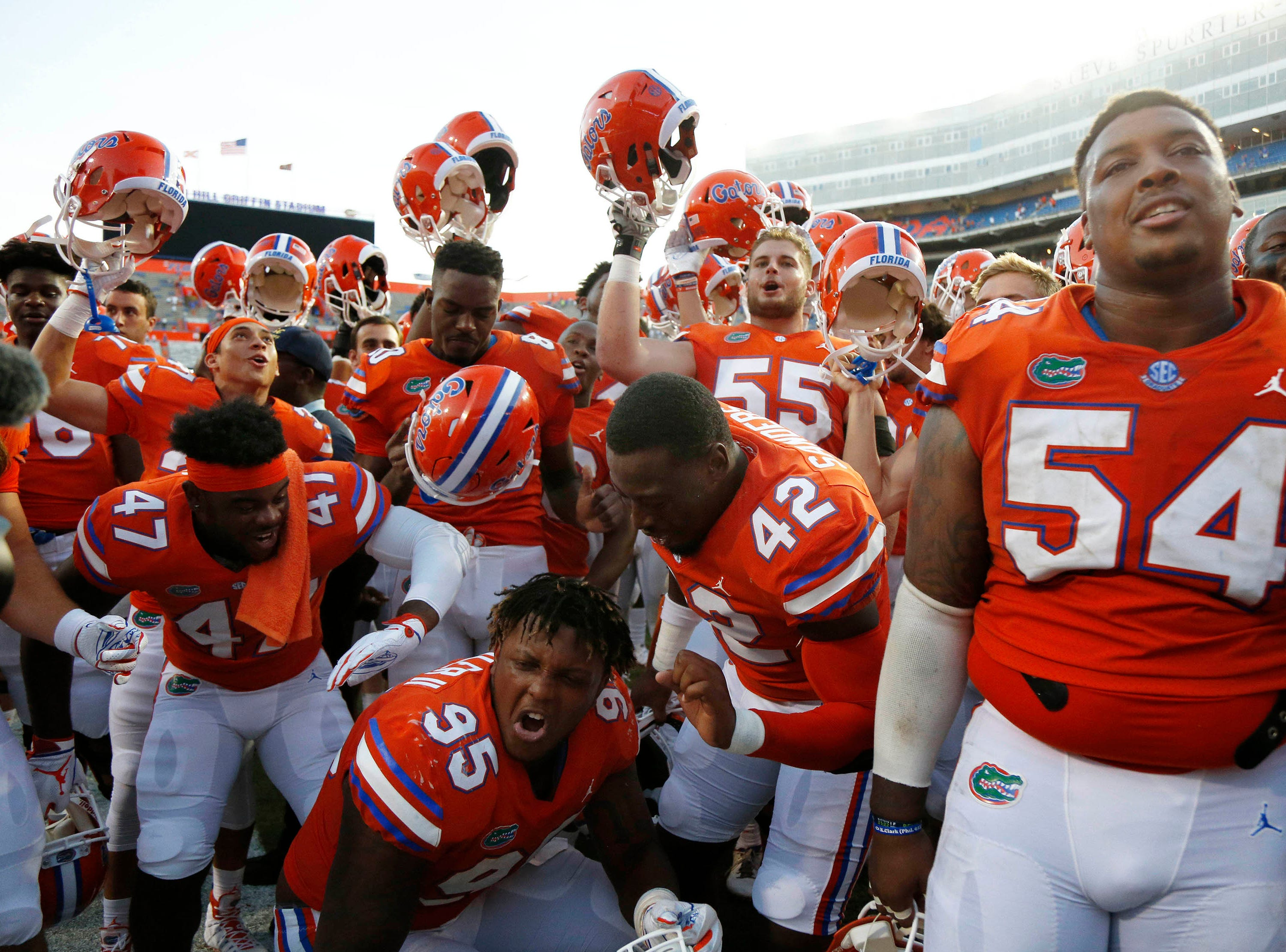 Sep 15, 2018; Gainesville, FL, USA; Florida Gators defensive lineman Adam Shuler II (95), linebacker Umstead Sanders (42), tight end C'yontai Lewis (80) and teammates celebrate as they beat the Colorado State Rams during the second half at Ben Hill Griffin Stadium. Mandatory Credit: Kim Klement-USA TODAY Sports