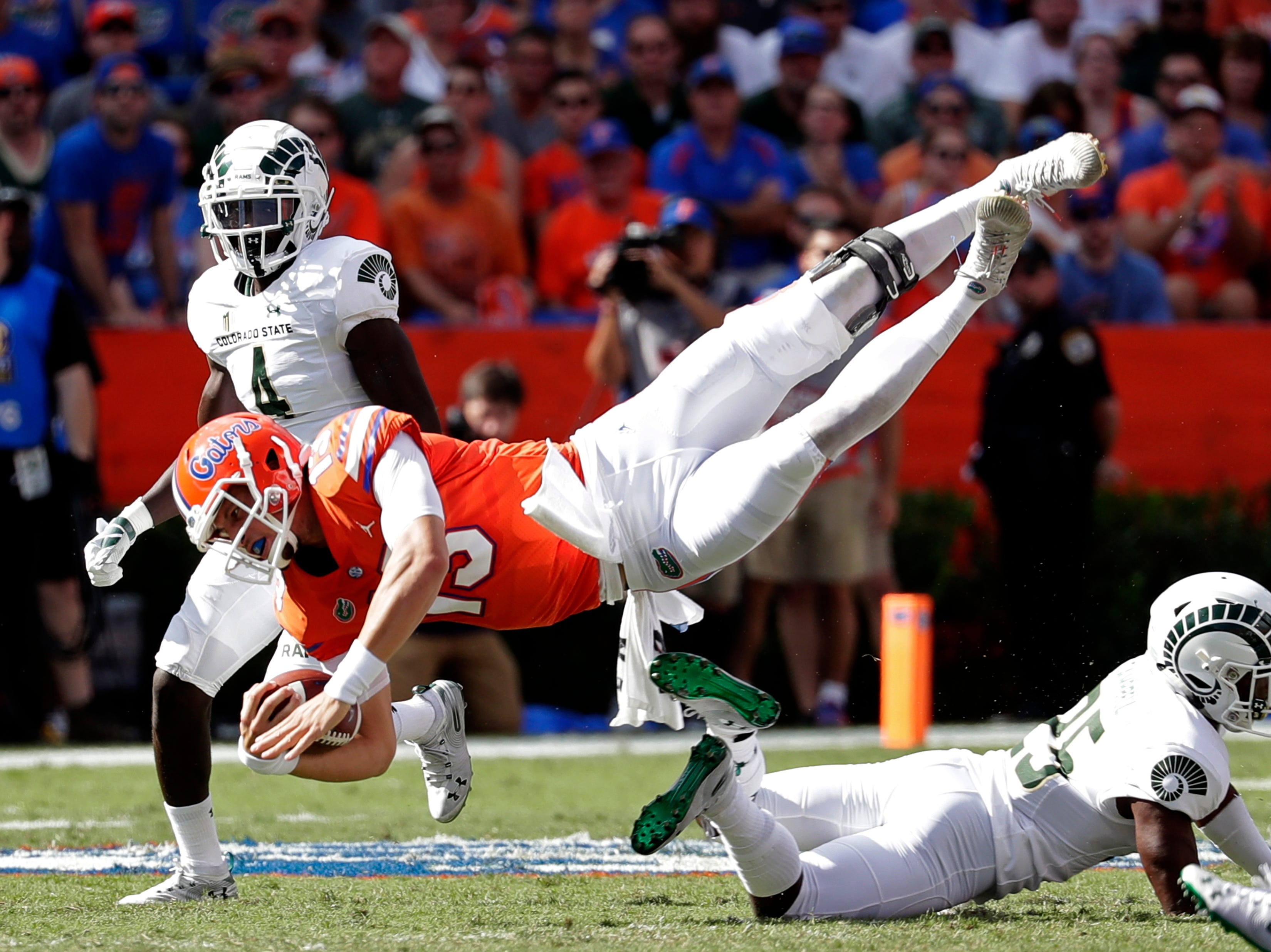 Florida quarterback Feleipe Franks (13) is upended by Colorado State cornerback Darius Campbell (25) during the first half of an NCAA college football game, Saturday, Sept. 15, 2018, in Gainesville, Fla. (AP Photo/John Raoux)