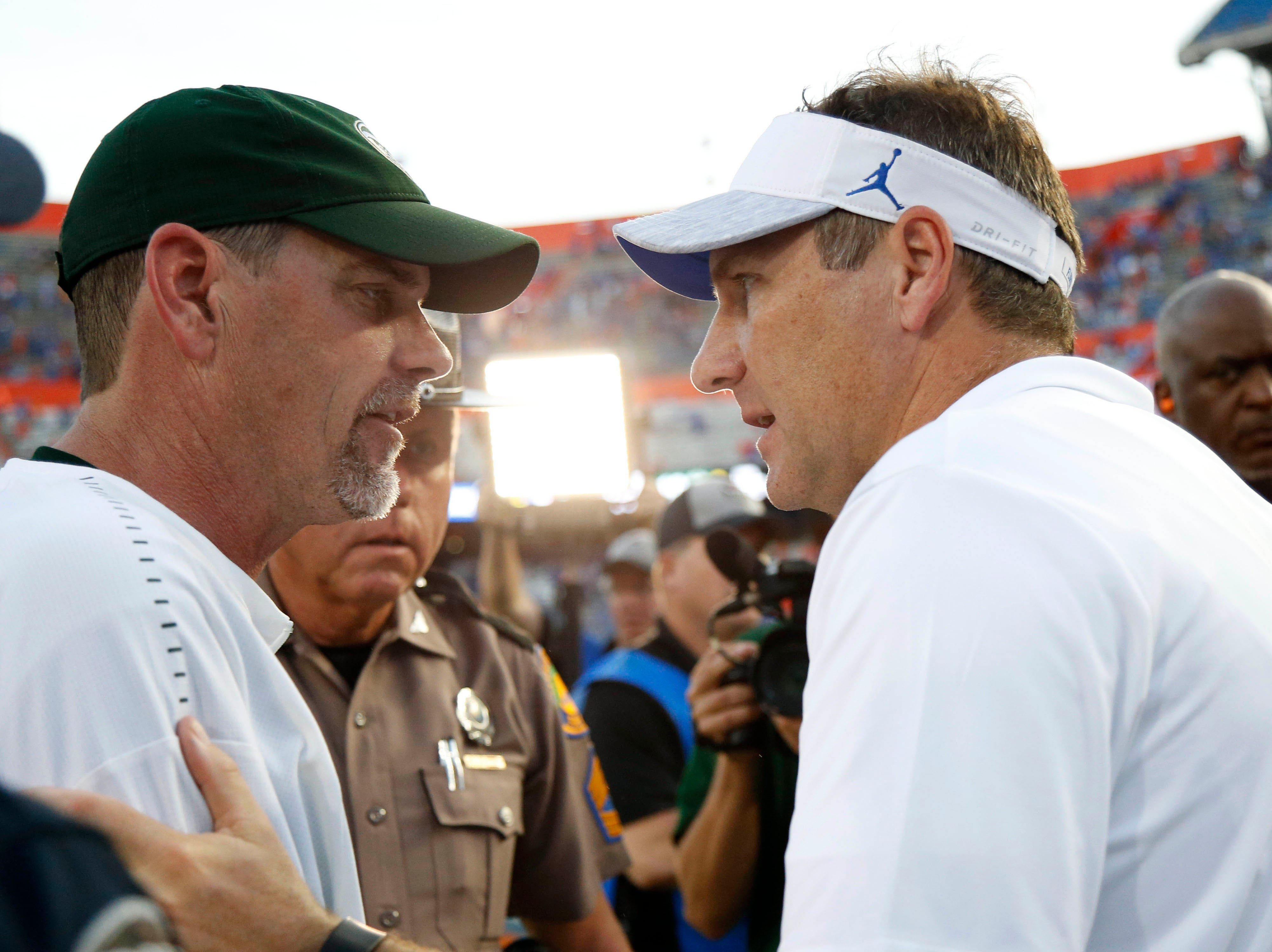 Sep 15, 2018; Gainesville, FL, USA; Colorado State Rams head coach Mike Bobo and Florida Gators head coach Dan Mullen greet after the game at Ben Hill Griffin Stadium. Mandatory Credit: Kim Klement-USA TODAY Sports