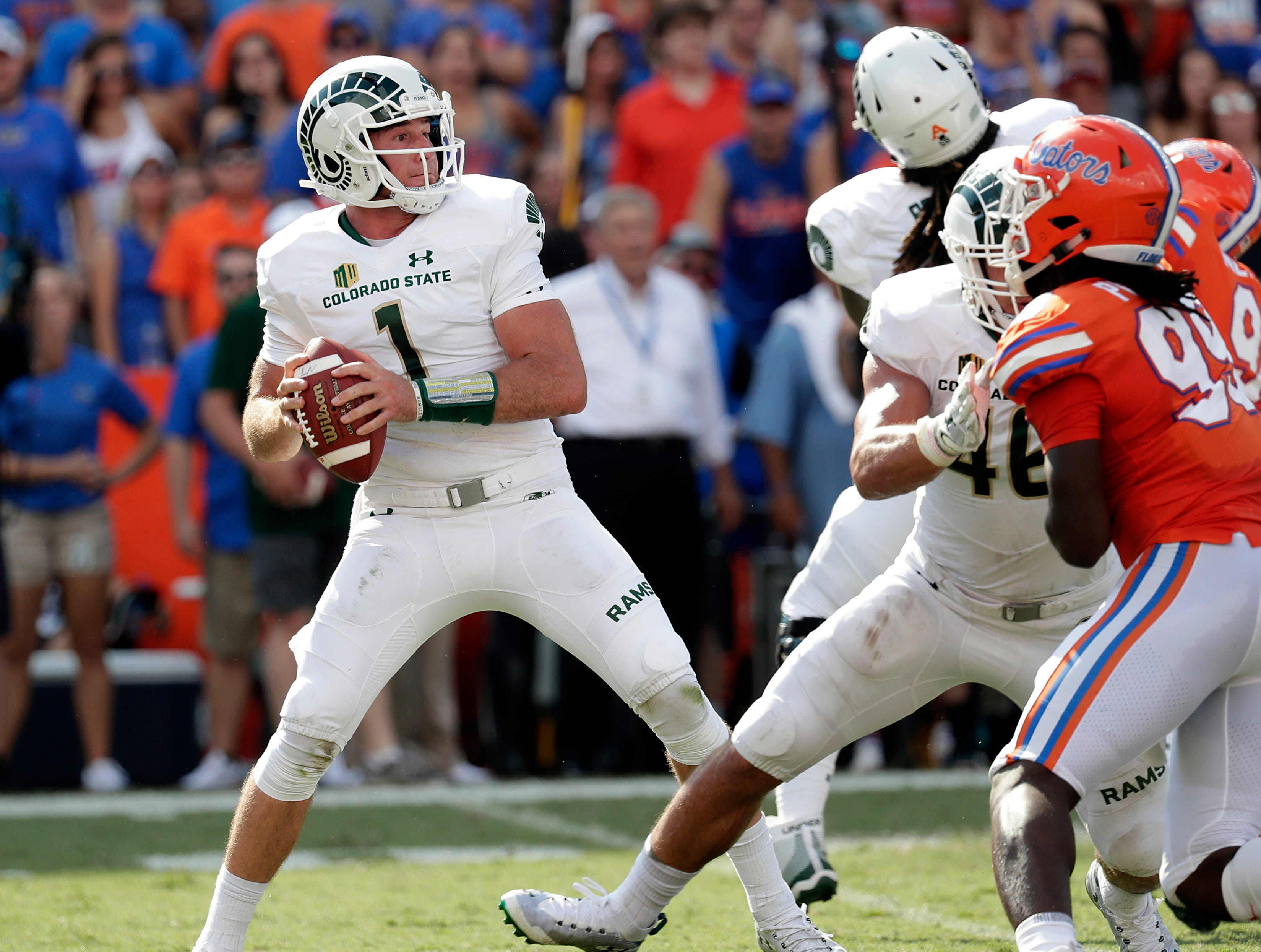 Colorado State quarterback K.J. Carta-Samuels looks for a receiver against Florida during the first half of an NCAA college football game, Saturday, Sept. 15, 2018, in Gainesville, Fla. (AP Photo/John Raoux)