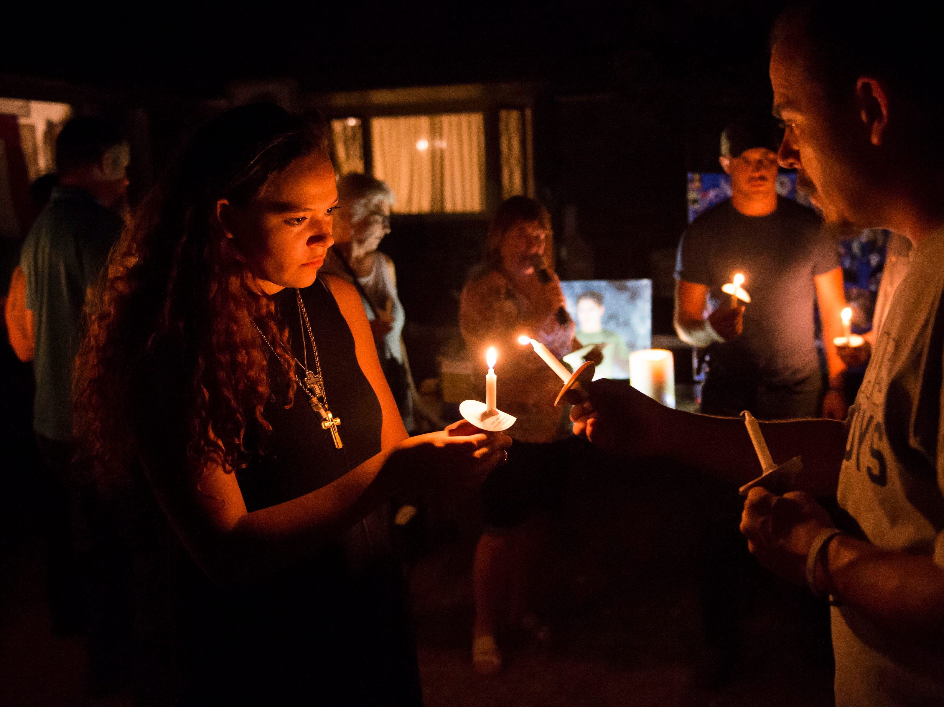 Mourners light candles during a vigil in front of the home of Aric Whaley, a 17 year old who was fatally shot at the home early Tuesday morning, Sept. 4, as seen on Saturday, Sept. 15, 2018, in Loveland, Colo. Gabriel Jesus Romero Ventura, 18, was arrested by Loveland police less than a mile from the residence on suspicion of manslaughter, first-degree assault and prohibited use of a weapon.