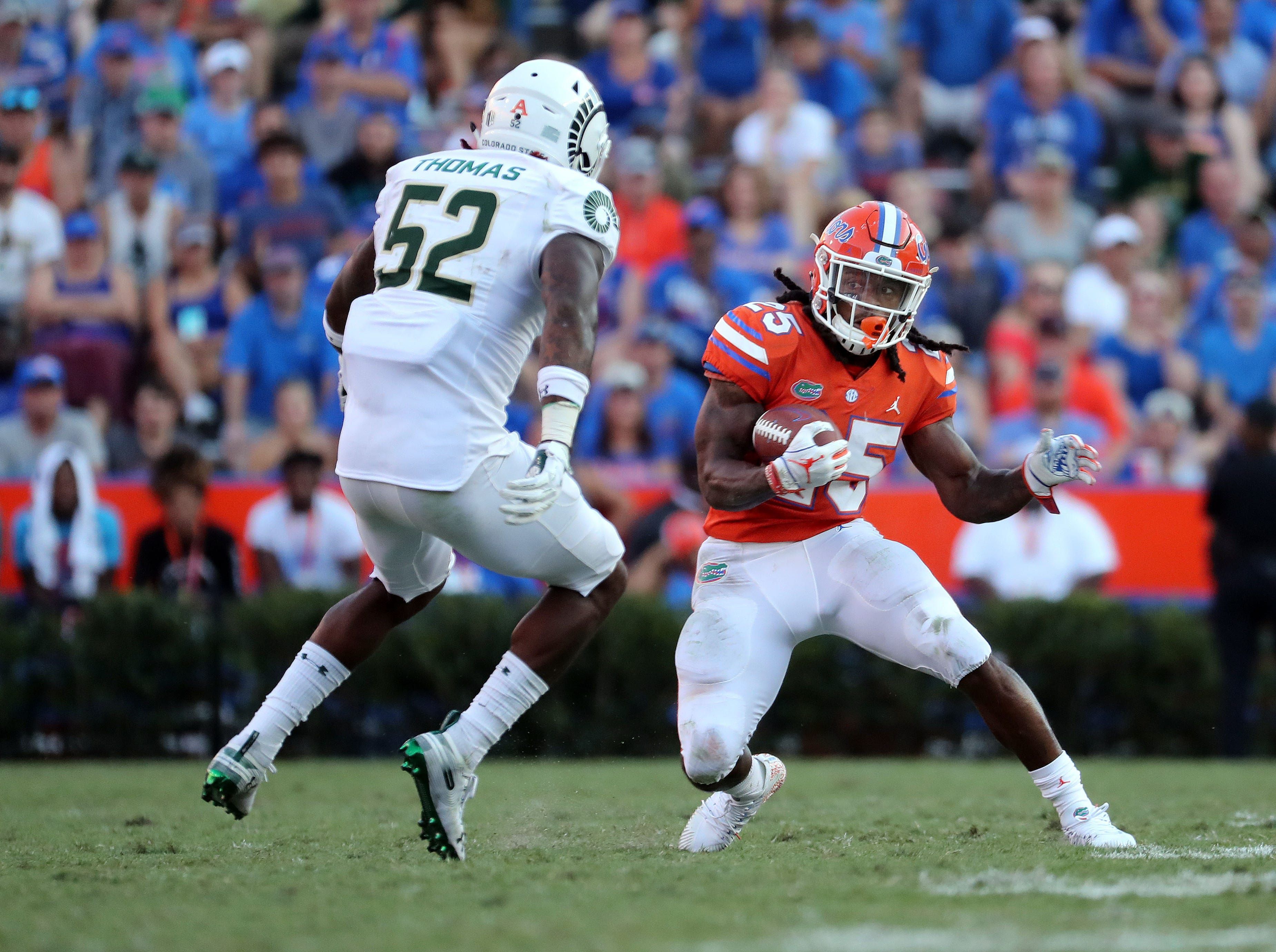 Sep 15, 2018; Gainesville, FL, USA; Florida Gators running back Jordan Scarlett (25) runs with the ball against Colorado State Rams linebacker Tre Thomas (52) during the second half at Ben Hill Griffin Stadium. Mandatory Credit: Kim Klement-USA TODAY Sports