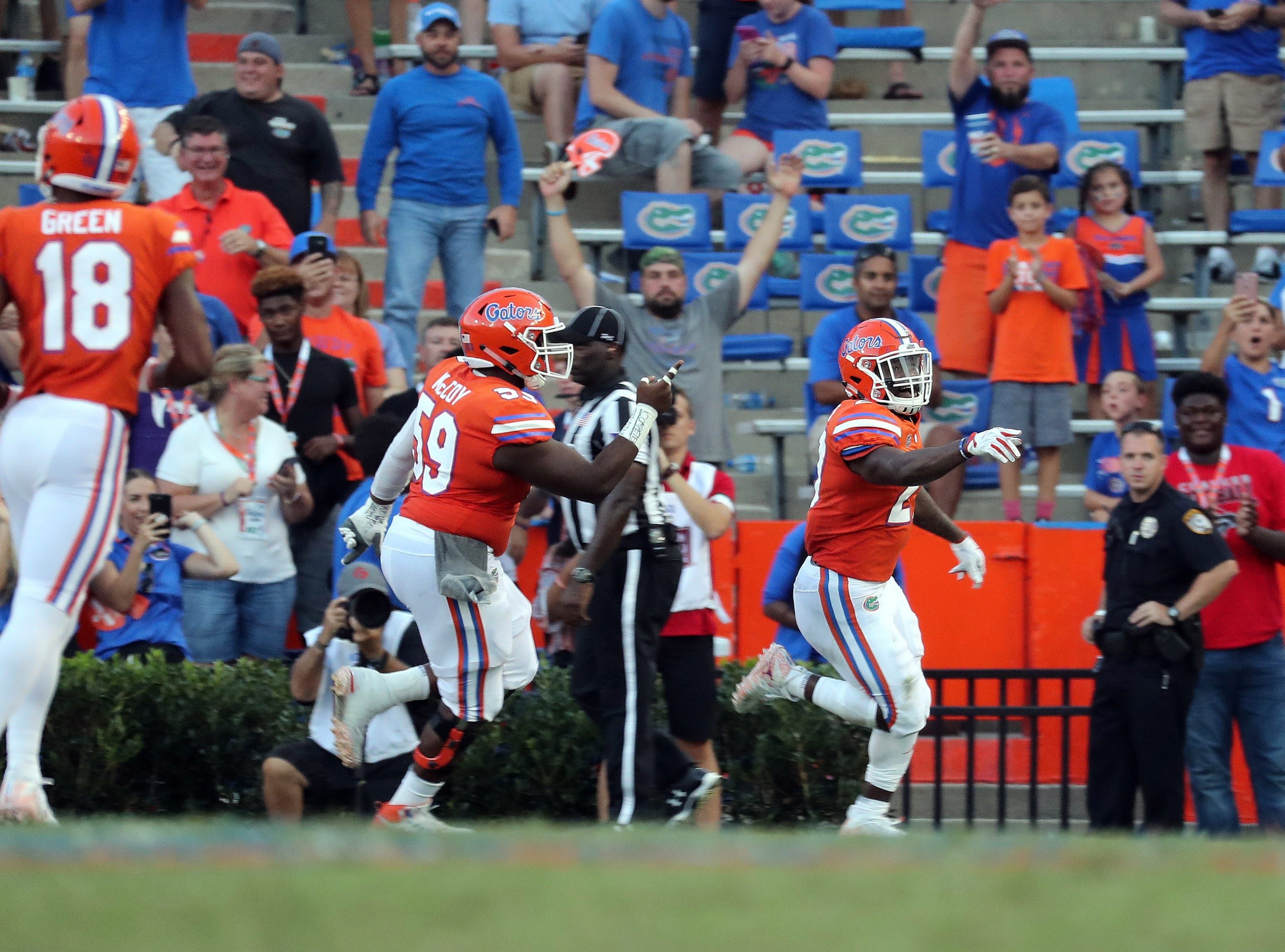 Sep 15, 2018; Gainesville, FL, USA; Florida Gators running back Dameon Pierce (27)  is congratulated after scoring a touchdown against the Colorado State Rams during the second half at Ben Hill Griffin Stadium. Mandatory Credit: Kim Klement-USA TODAY Sports