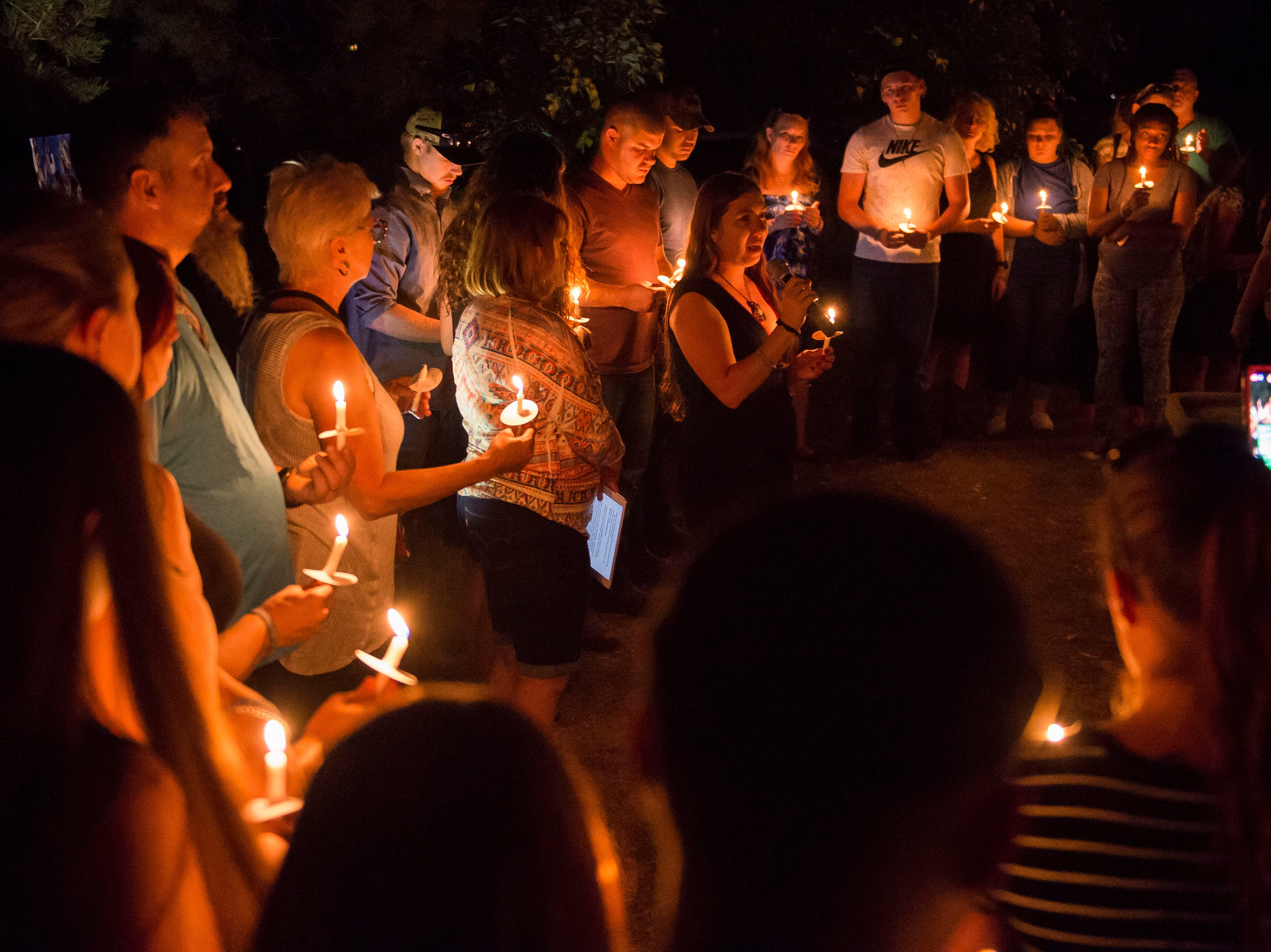 Mourners gather for a vigil in front of the home of Aric Whaley, a 17 year old who was fatally shot at the home early Tuesday morning, Sept. 4, as seen on Saturday, Sept. 15, 2018, in Loveland, Colo. Gabriel Jesus Romero Ventura, 18, was arrested by Loveland police less than a mile from the residence on suspicion of manslaughter, first-degree assault and prohibited use of a weapon.