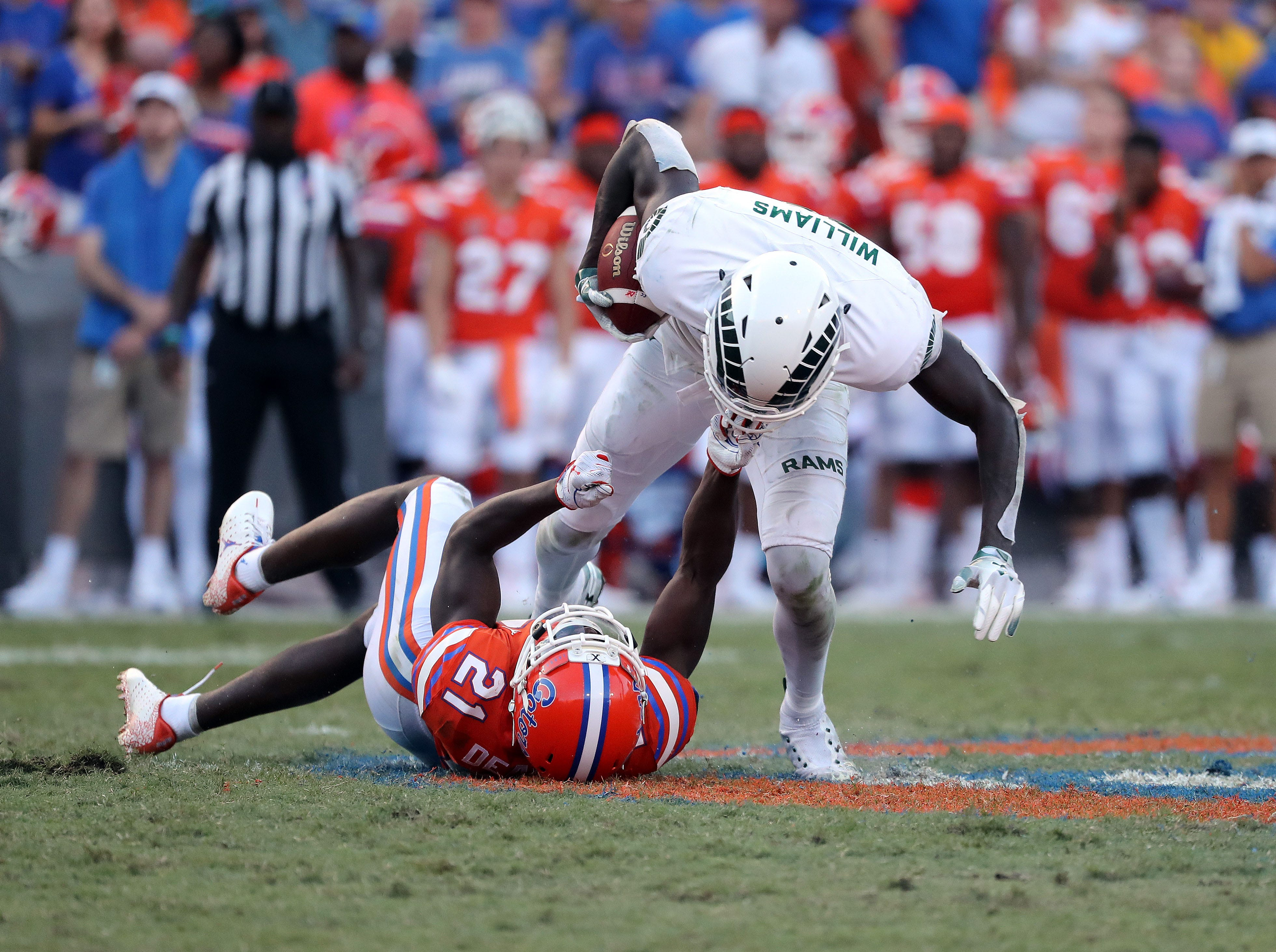 Sep 15, 2018; Gainesville, FL, USA; Colorado State Rams wide receiver Preston Williams (11)  is face masked by Florida Gators defensive back Trey Dean III (21) after catching a pass during the second half at Ben Hill Griffin Stadium. Mandatory Credit: Kim Klement-USA TODAY Sports