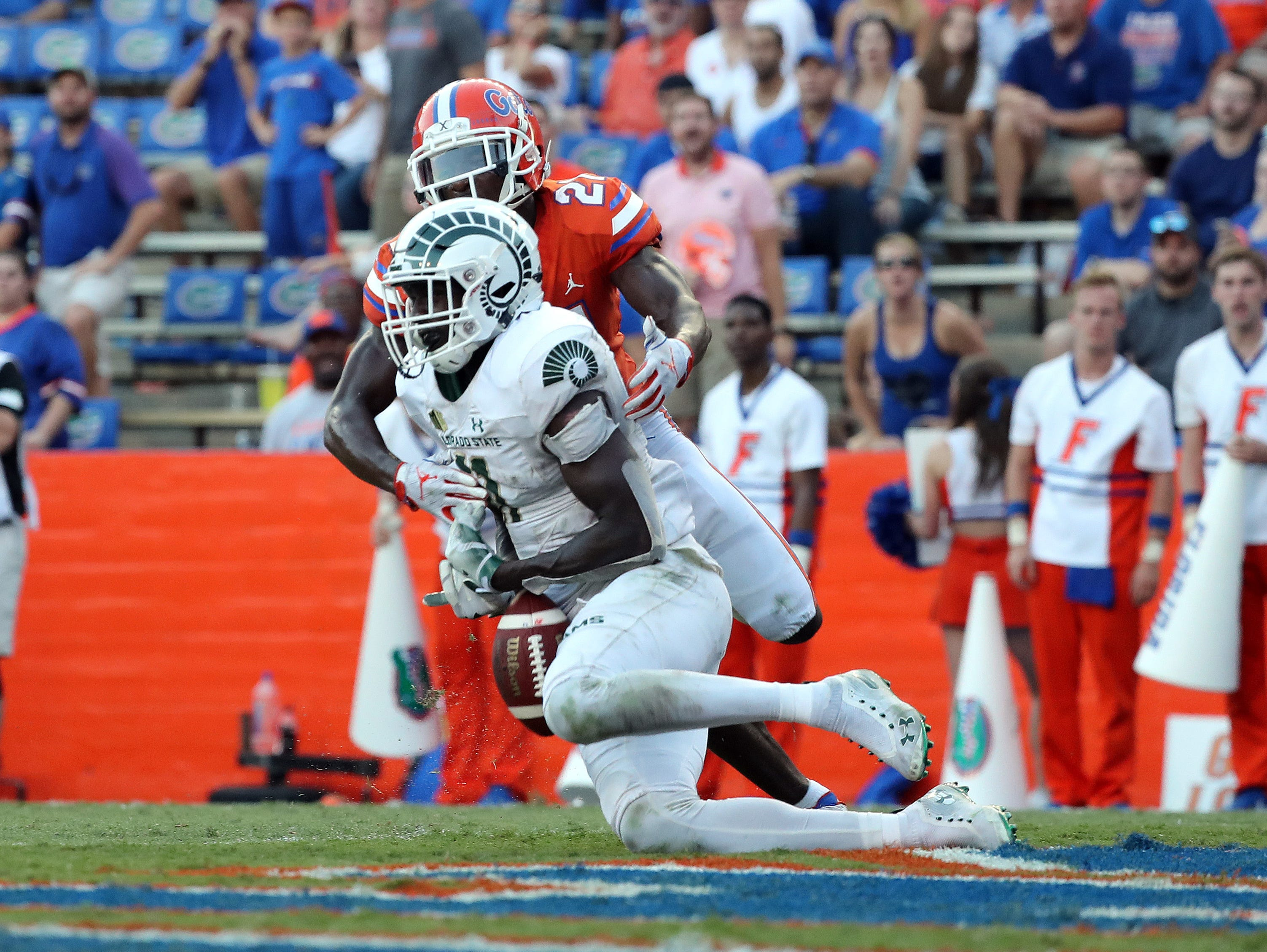 Sep 15, 2018; Gainesville, FL, USA; Florida Gators defensive back Trey Dean III (21) breaks up a pass intended for Colorado State Rams wide receiver Preston Williams (11) in the end zone during the second half at Ben Hill Griffin Stadium. Mandatory Credit: Kim Klement-USA TODAY Sports
