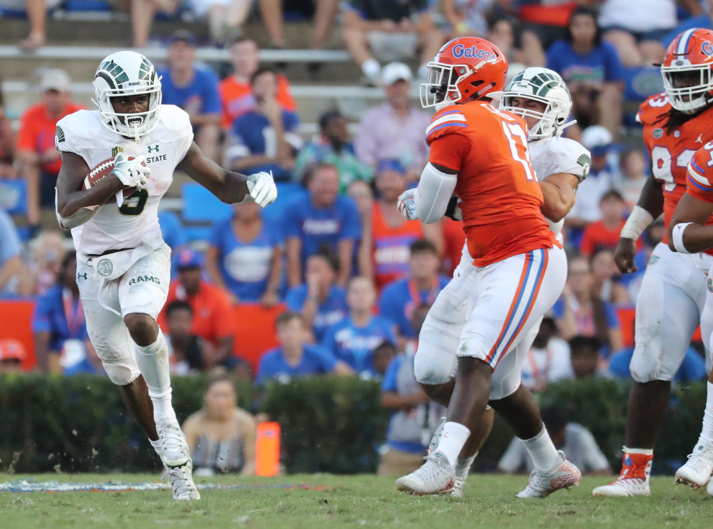 Sep 15, 2018; Gainesville, FL, USA; Colorado State Rams running back Marvin Kinsey Jr. (5) runs with the ball against the Florida Gators during the second half at Ben Hill Griffin Stadium. Mandatory Credit: Kim Klement-USA TODAY Sports