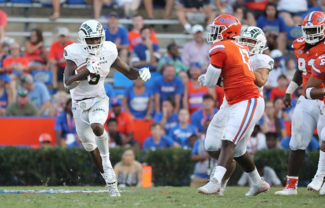 CSU running back Marvin Kinsey find some open field during Saturday's game against Florida. Kinsey led the Rams in rushing with 79 yards on 15 carries.
