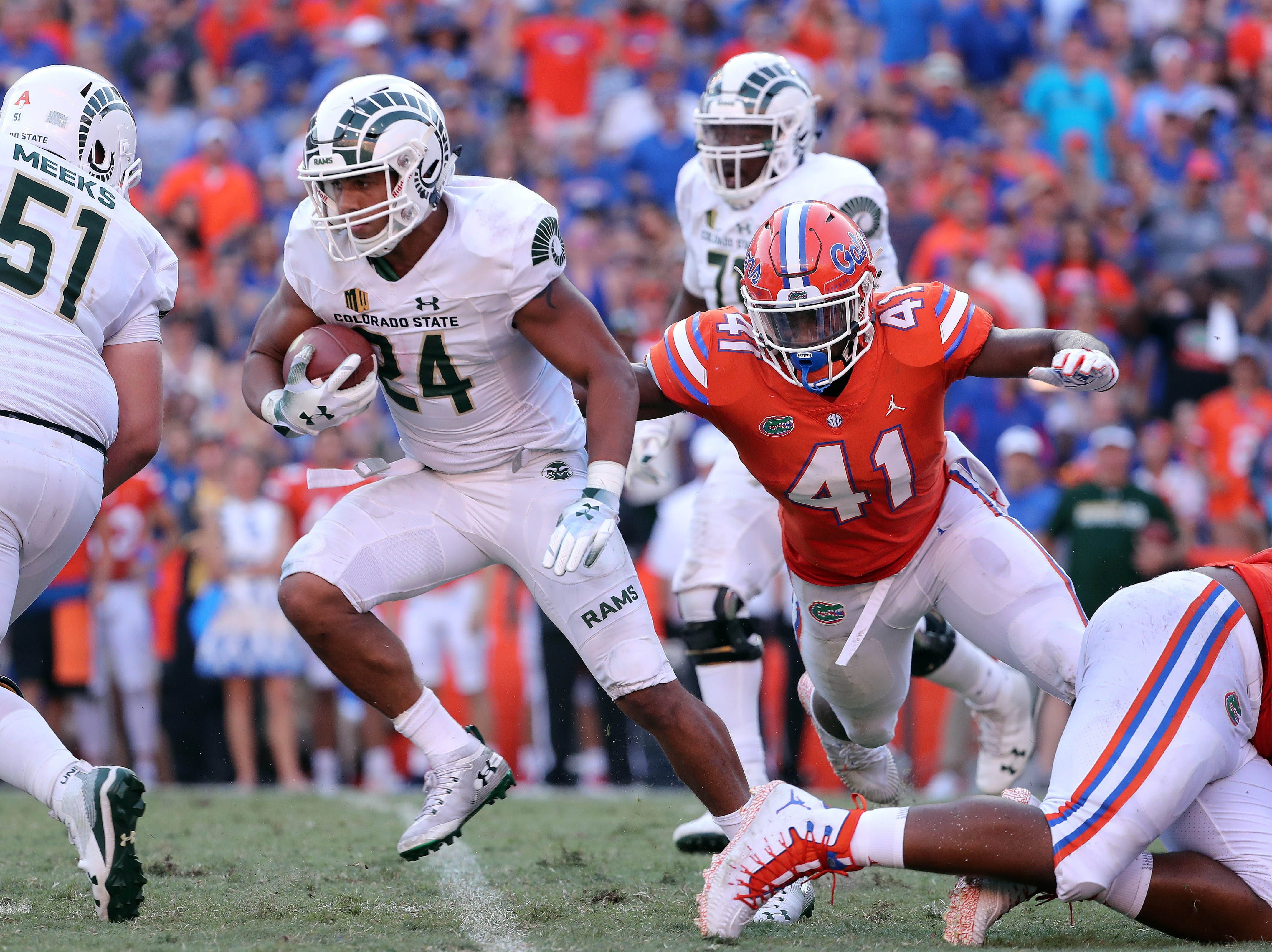 Sep 15, 2018; Gainesville, FL, USA; Colorado State Rams running back Izzy Matthews (24) runs with the ball against Florida Gators linebacker James Houston IV (41)  during the second half at Ben Hill Griffin Stadium. Mandatory Credit: Kim Klement-USA TODAY Sports