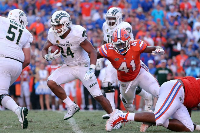 CSU running back Izzy Matthews breaks a tackle by Florida linebacker James Houston IV during Saturday's 48-10 loss to the Gators in Gainesville, Fla. Matthews and the Rams (1-3) hope to build some momentum heading into a bye next week by beating Illinois State in a home game this Saturday at Canvas Stadium.