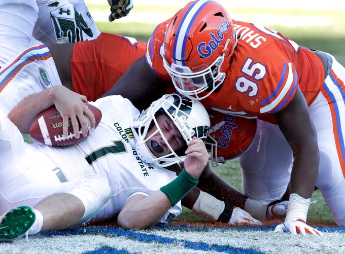 Colorado State quarterback K.J. Carta-Samuels (1) is sacked by Florida defensive lineman Adam Shuler II (95) during the first half of an NCAA college football game, Saturday, Sept. 15, 2018, in Gainesville, Fla. (AP Photo/John Raoux)