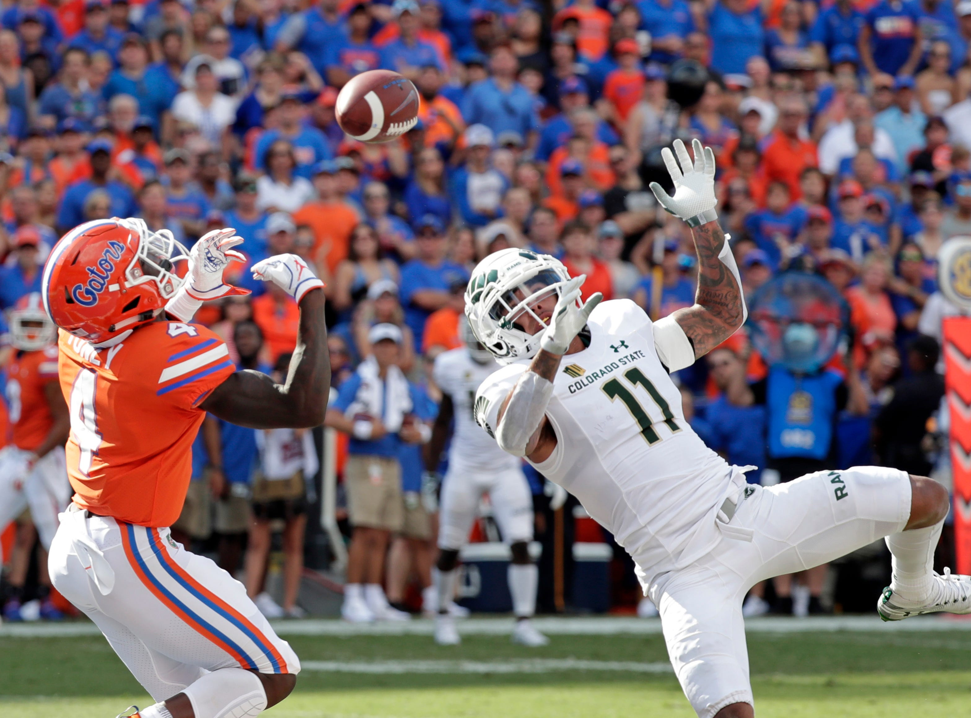 Colorado State safety Jordan Fogal (11) breaks up a pass intended for Florida running back Kadarius Toney (4) during the first half of an NCAA college football game, Saturday, Sept. 15, 2018, in Gainesville, Fla. (AP Photo/John Raoux)