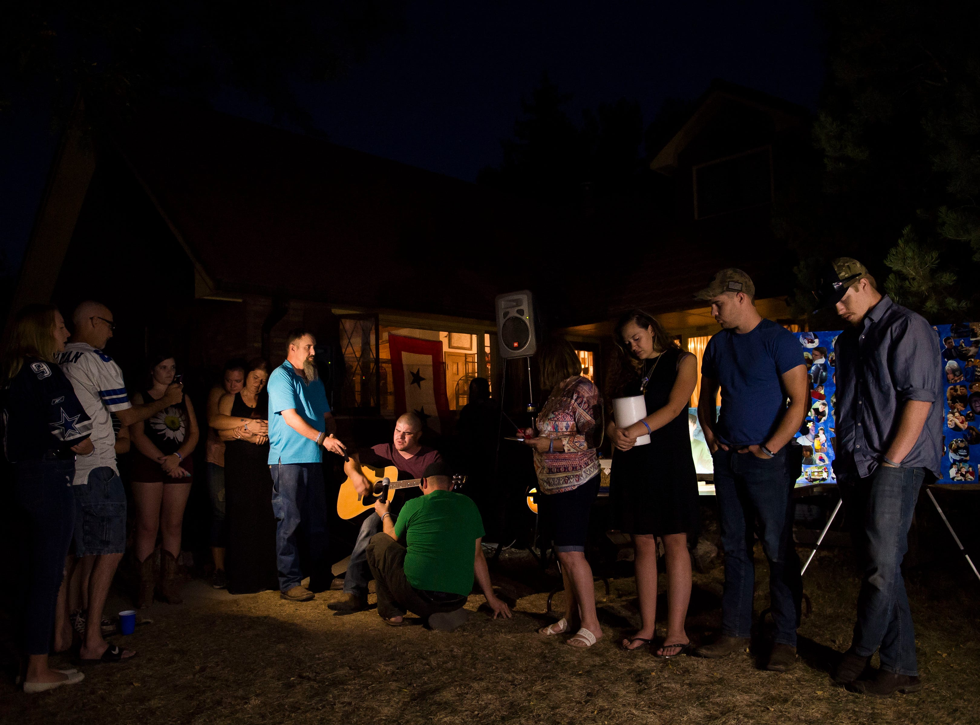 The immediate family of Aric Whaley, a 17 year old who was fatally shot at the home early Tuesday morning, Sept. 4, gather during a vigil on Saturday, Sept. 15, 2018, in Loveland, Colo. Gabriel Jesus Romero Ventura, 18, was arrested by Loveland police less than a mile from the residence on suspicion of manslaughter, first-degree assault and prohibited use of a weapon.