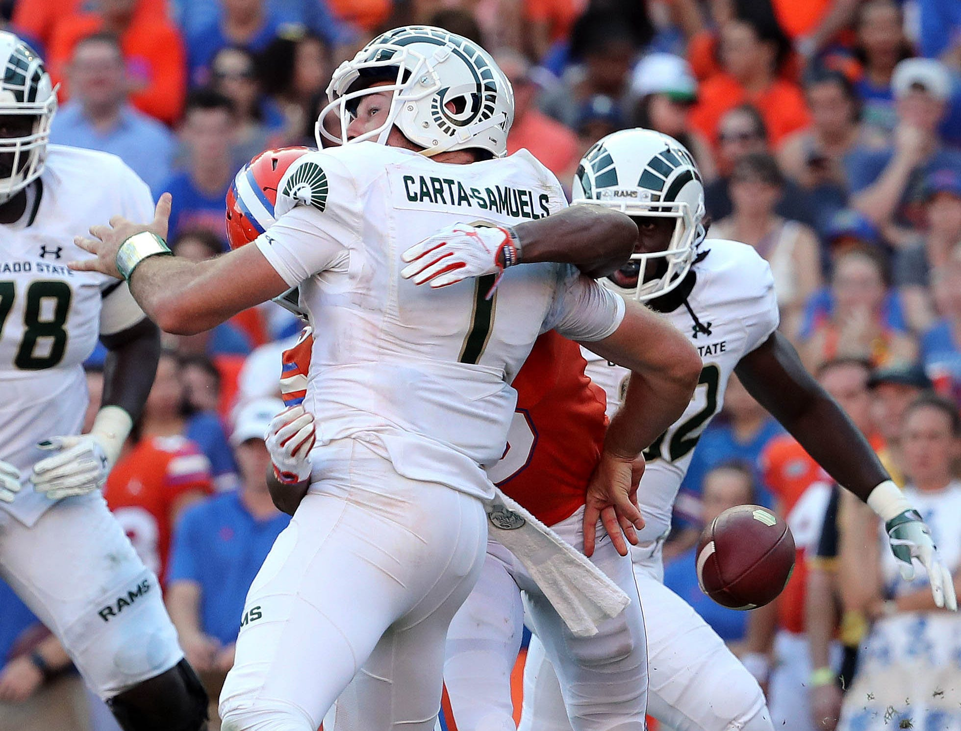 Sep 15, 2018; Gainesville, FL, USA;Florida Gators defensive back CJ Henderson (5) forces Colorado State Rams quarterback K.J. Carta-Samuels (1) to fumble the ball  during the second half at Ben Hill Griffin Stadium. Mandatory Credit: Kim Klement-USA TODAY Sports