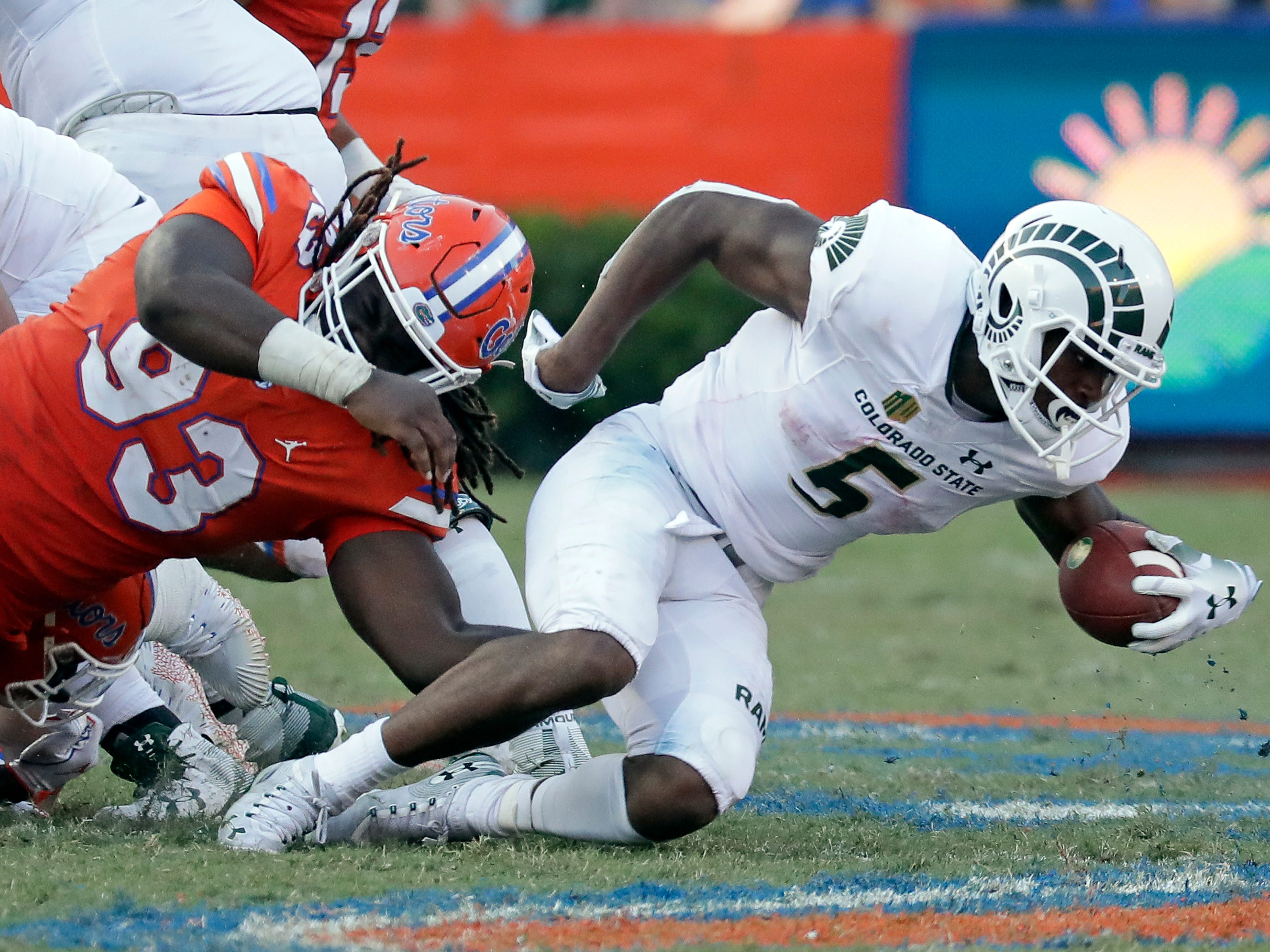 Colorado State running back Marvin Kinsey Jr. (5) is tackled by Florida defensive end Elijah Conliffe (93) during the second half of an NCAA college football game, Saturday, Sept. 15, 2018, in Gainesville, Fla. (AP Photo/John Raoux)