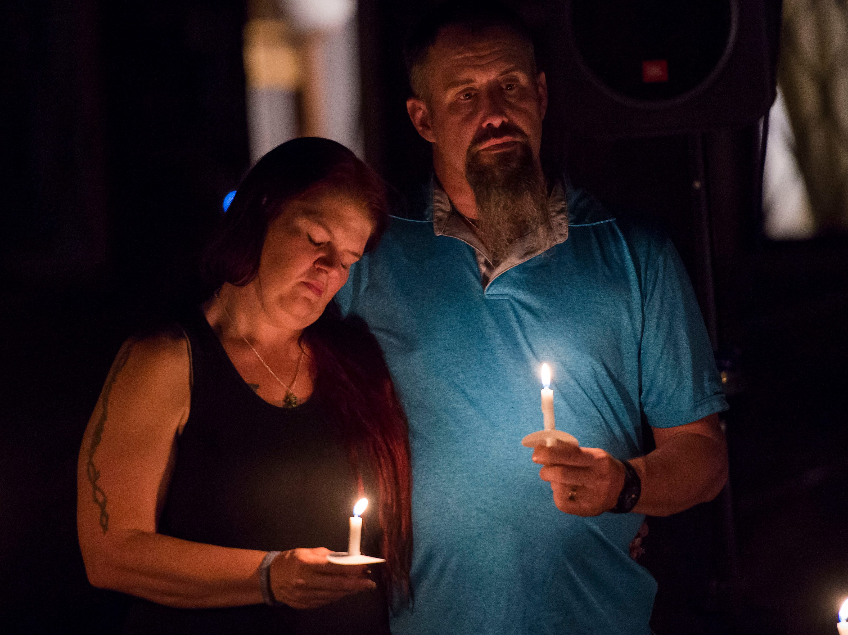 Penny and Dave Whaley, parents of Aric Whaley, a 17 year old who was fatally shot at his home early Tuesday morning, Sept. 4, comfort each during a vigil in front of the home on Saturday, Sept. 15, 2018, in Loveland, Colo. Gabriel Jesus Romero Ventura, 18, was arrested by Loveland police less than a mile from the residence on suspicion of manslaughter, first-degree assault and prohibited use of a weapon.