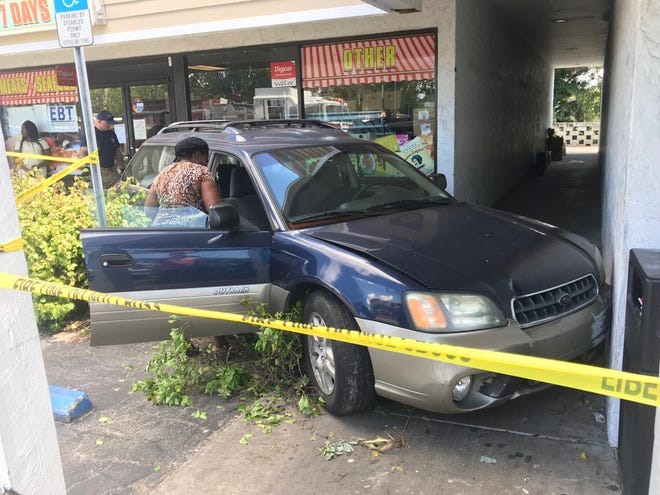 A car crashed through bushes and into a building at 3517 Fowler Street on Sunday shortly before 1 p.m. The car narrowly missed the Carnival Grocery Store and then hit the corner of an empty storefront next door. No injuries were reported.