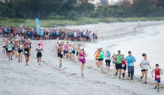 Hundreds of athletes compete on Sunday in the Galloway Captiva Triathlon in Captiva, Florida. The recent red tide outbreak forced race organizers to replace the swim portion with a quarter mile run on the beach.