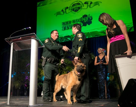 Deputy Julio Lock is congratulated after his dog Kilo was named the K9 of the year on Saturday at the Law and Order Ball in Estero.