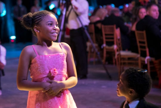 Rosalyn Baldwin, 8, smiles after being introduced at the Law and Order Ball on Saturday at Germain Arena. Baldwin has made it her mission to hug police officers in every state. So far, she has made it to 35 states.