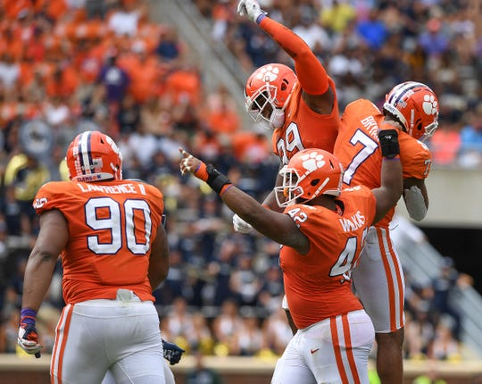 Clemson defensive lineman Austin Bryant (7) celebrates with defensive linemen Clelin Ferrell (99), Christian Wilkins (42), and Dexter Lawrence (90) after sacking Georgia Southern quarterback Shai Werts (4) during the 4th quarter Saturday, September 15, 2018, at Clemson's Memorial Stadium.