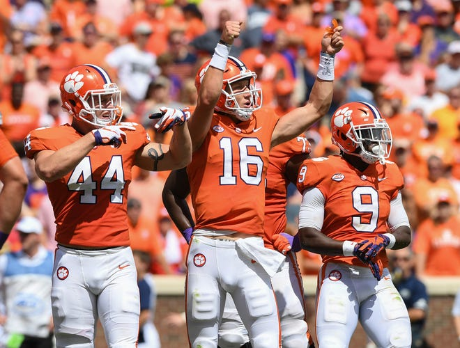 Clemson quarterback Trevor Lawrence (16) looks to the bench for a play during the 2nd quarter Saturday, September 15, 2018, at Clemson's Memorial Stadium.
