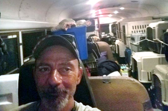 East Tennessee resident Tony Alsup in his school bus with shelter pets from South Carolina.