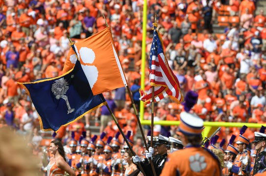 Wind blows the color guards flags during pregame Saturday, September 15, 2018, at Clemson's Memorial Stadium.