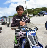 Motocross competitor Jerisha Guzman, 9,  before her Monster Energy 2018 Guam Motocross Championship race at Guam International Raceway in Yigo, Sept. 16, 2016.